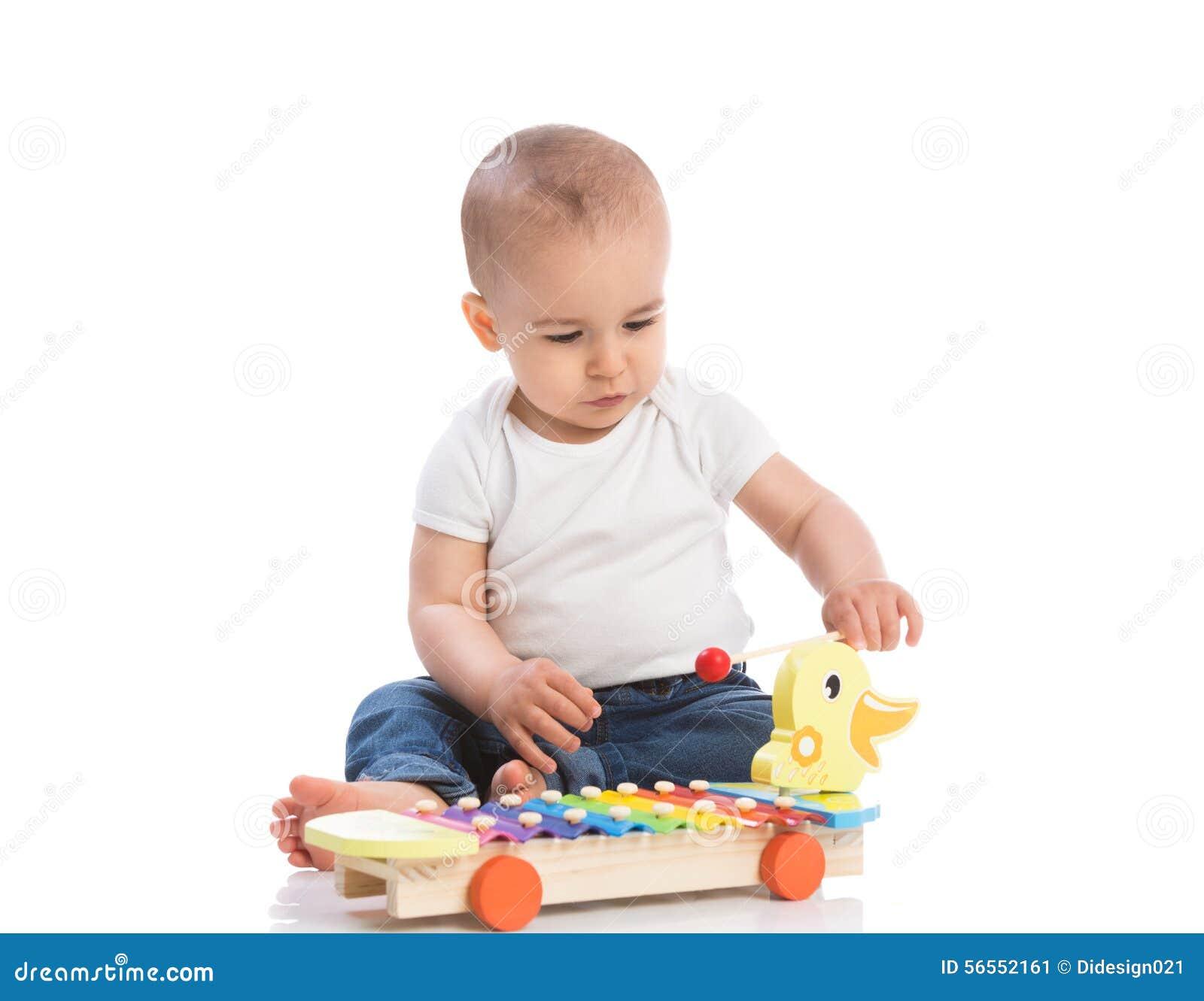 Download Παίζοντας κρούση μωρών στοκ εικόνα. εικόνα από εκμάθηση - 56552161