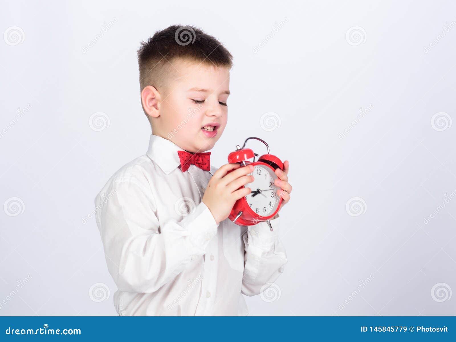 Παιδιών λατρευτός αγοριών άσπρος δεσμός τόξων πουκάμισων κόκκινος Αναπτύξτε τη μόνη πειθαρχία Ξυπνητήρι οργάνωσης Κόκκινο ρολόι λ