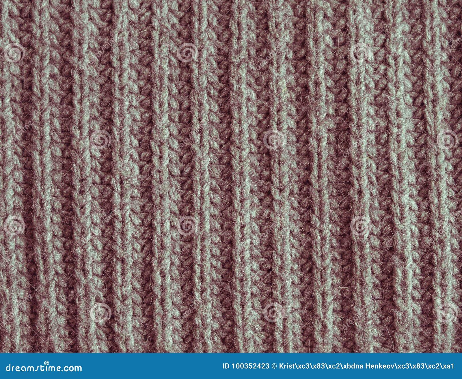 Παλαιός εξασθενίστε το κόκκινο ή ρόδινο πλεκτό μαλλί αφηρημένο υπόβαθρο σύστασης