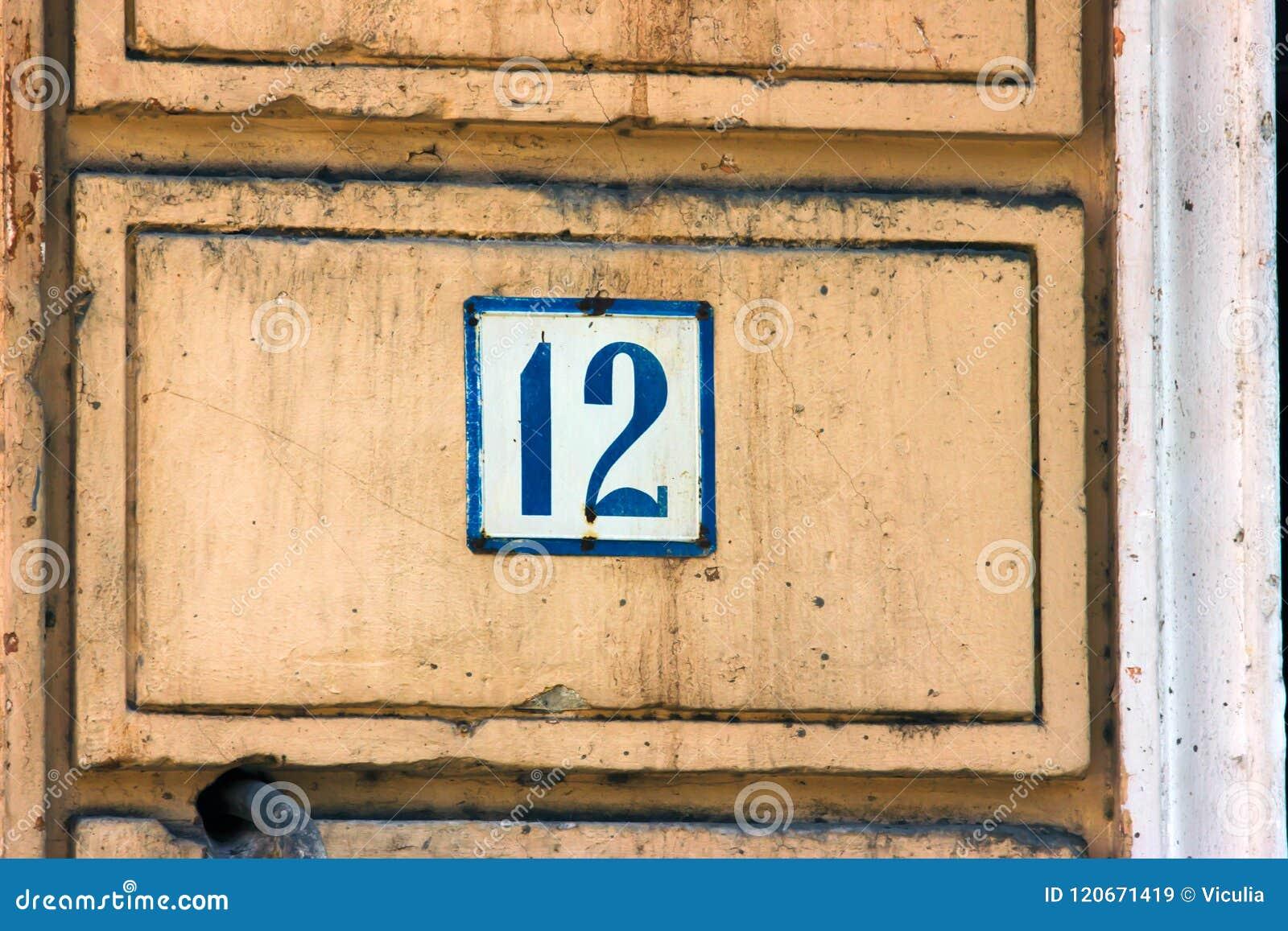 Παλαιό εκλεκτής ποιότητας μπλε μέταλλο αριθμός 12 δώδεκα διευθύνσεων σπιτιών