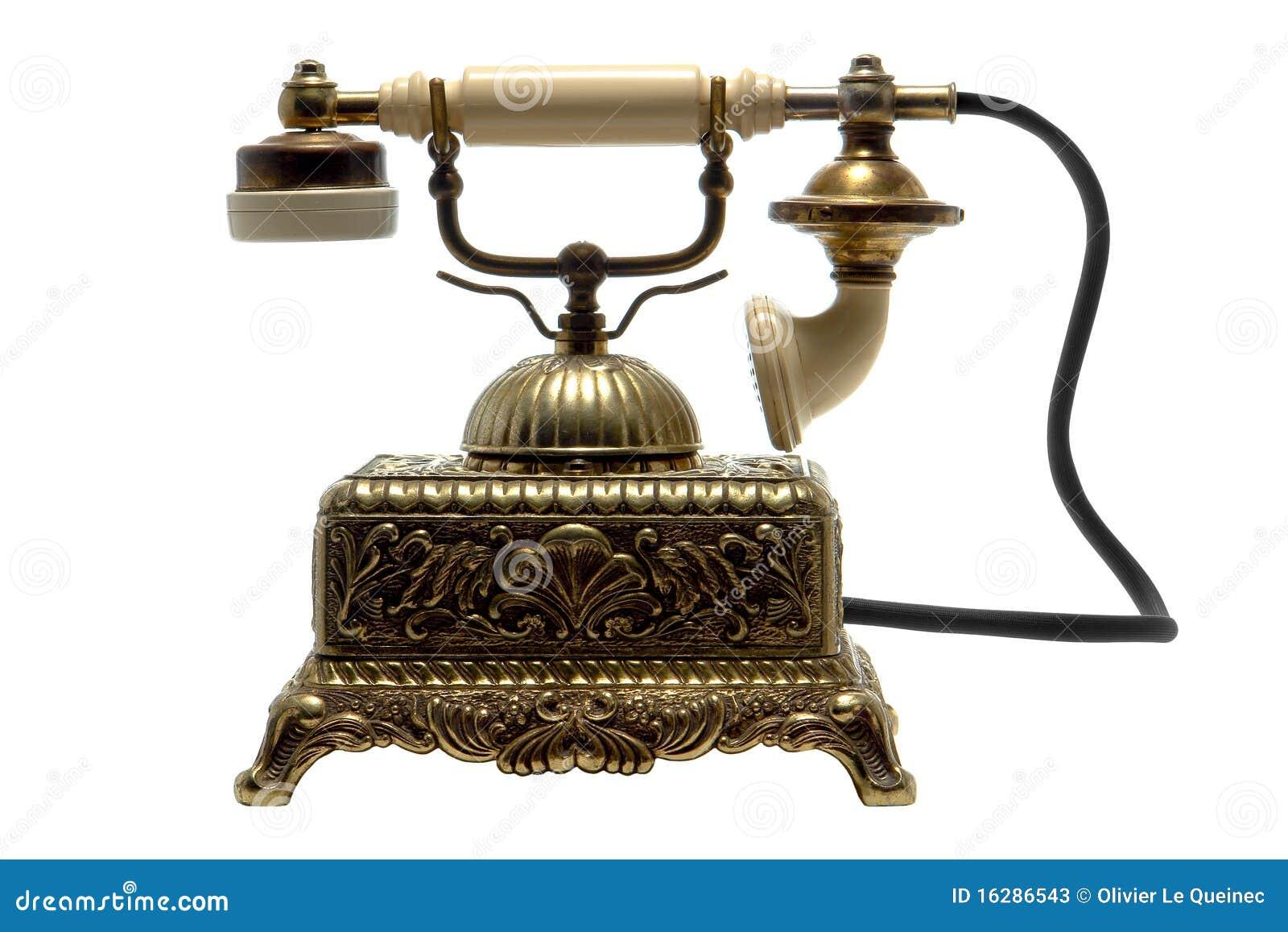 Παλαιό τηλέφωνο λίκνων ορείχαλκου που απομονώνεται στο λευκό