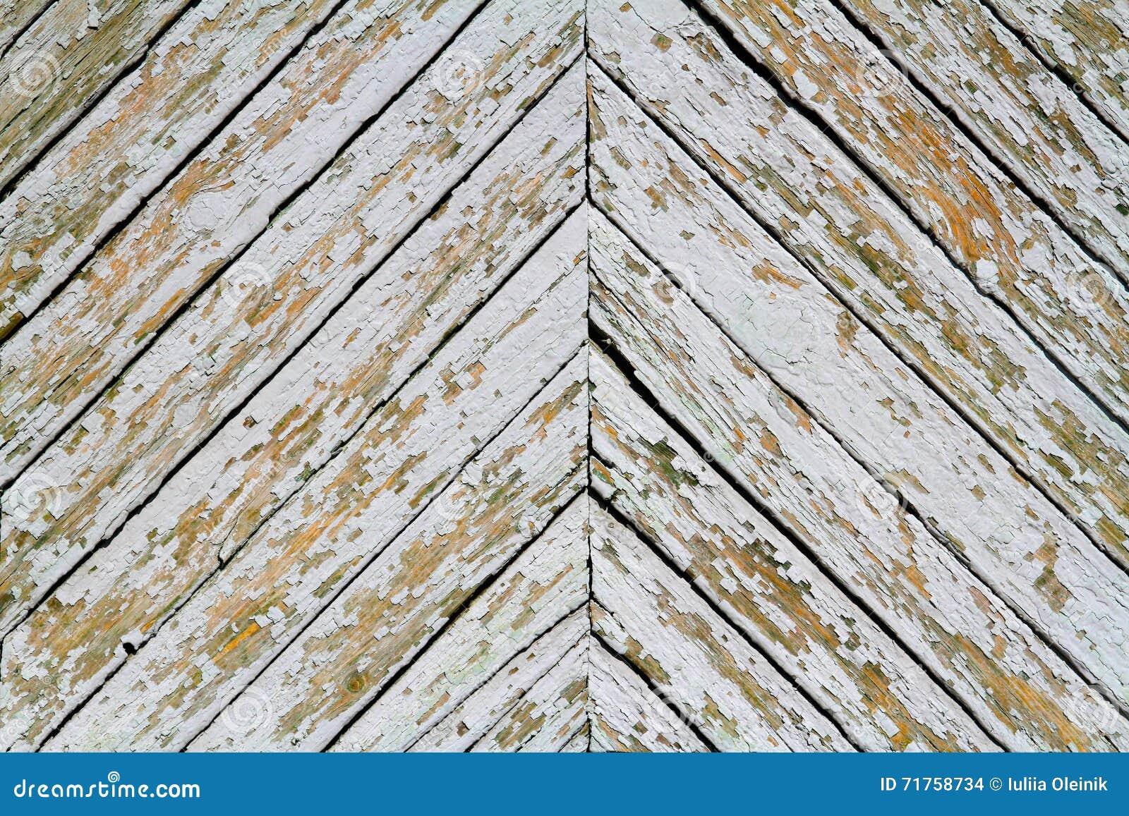 Παλαιά ξύλινη σανίδα σε ένα σχέδιο ψαροκόκκαλων
