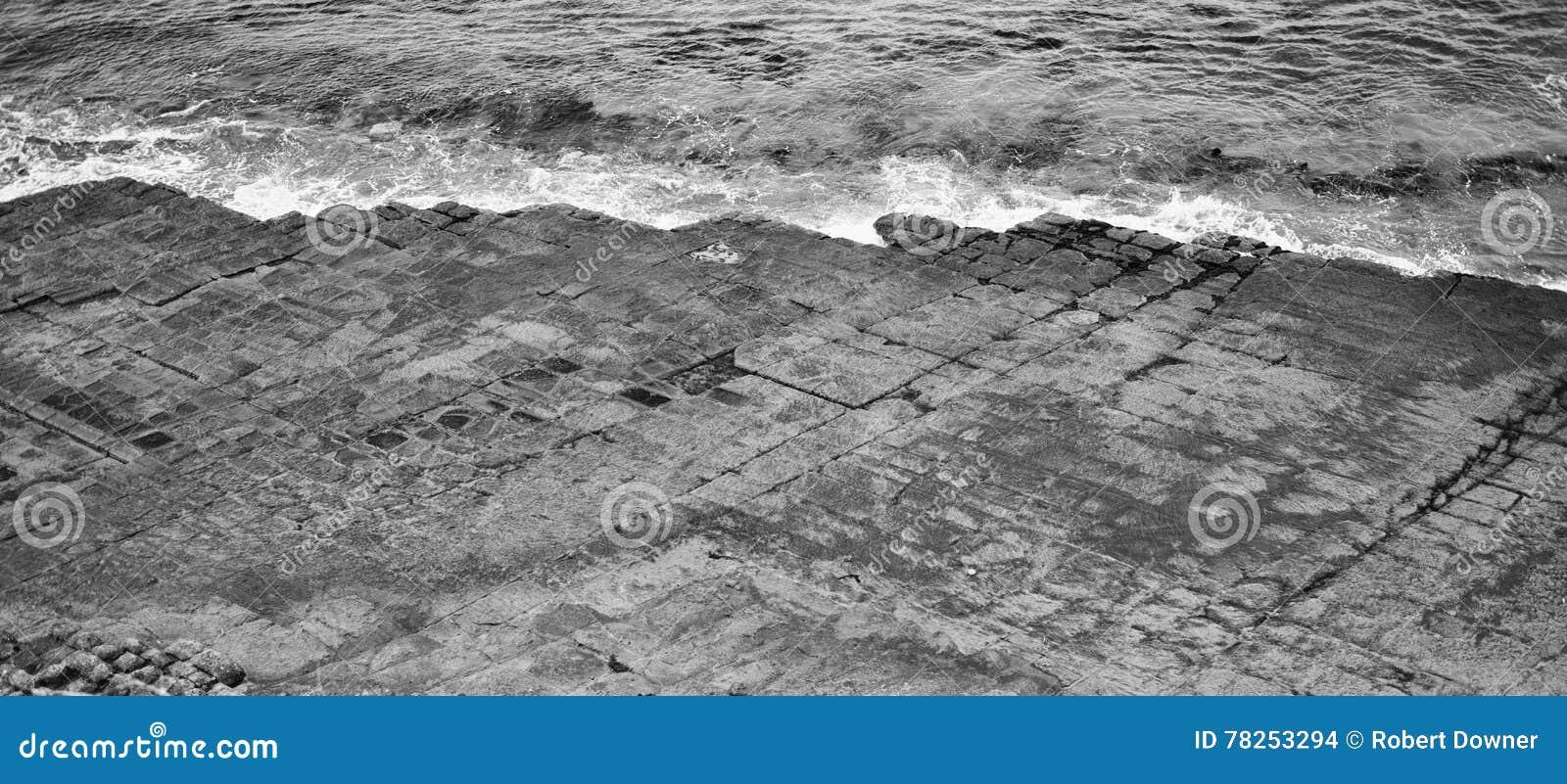 Πεζοδρόμιο Tessellated στον κόλπο πειρατών μαύρο λευκό