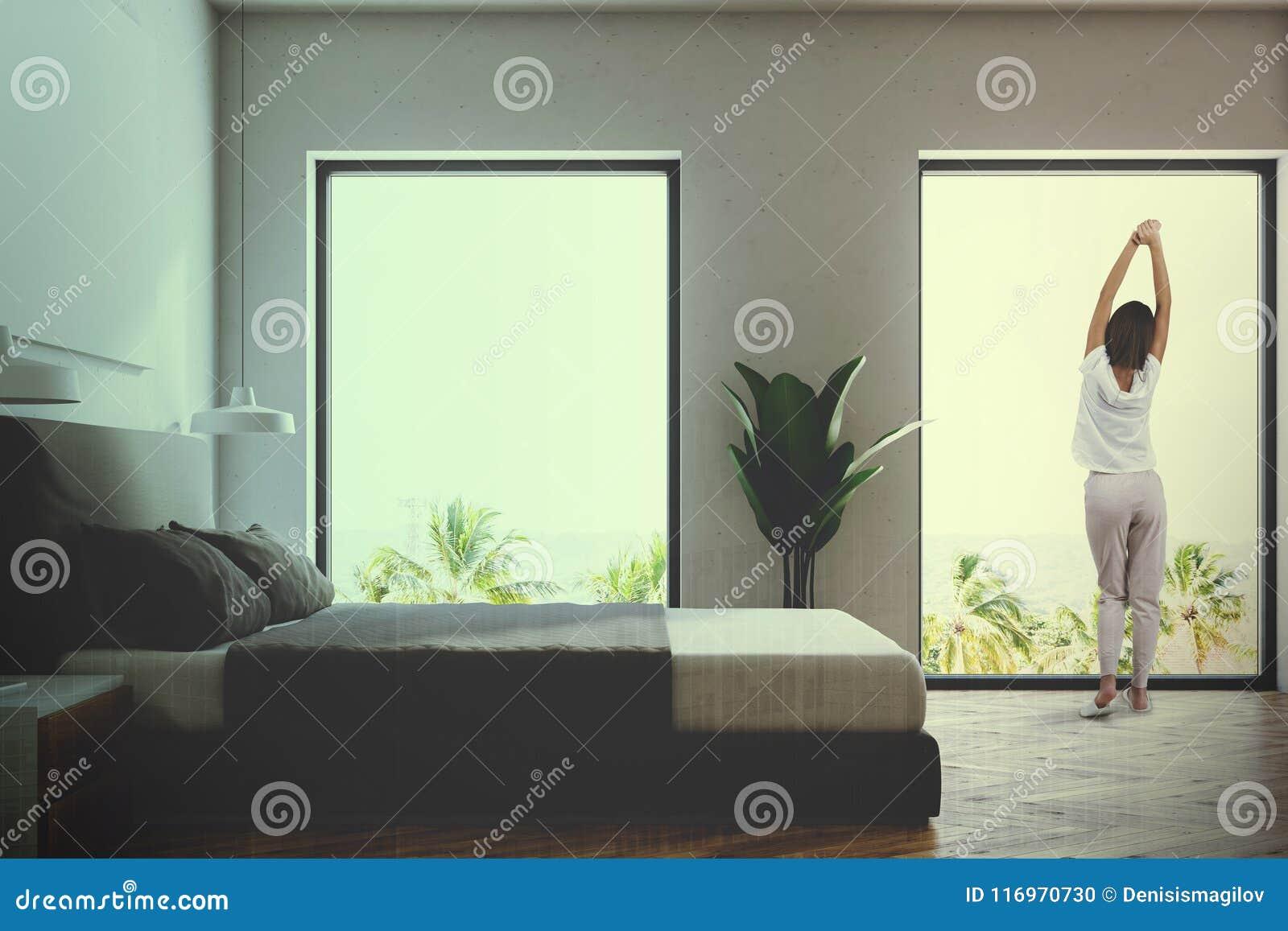 Πλάγια όψη μιας άσπρης κρεβατοκάμαρας που τονίζεται