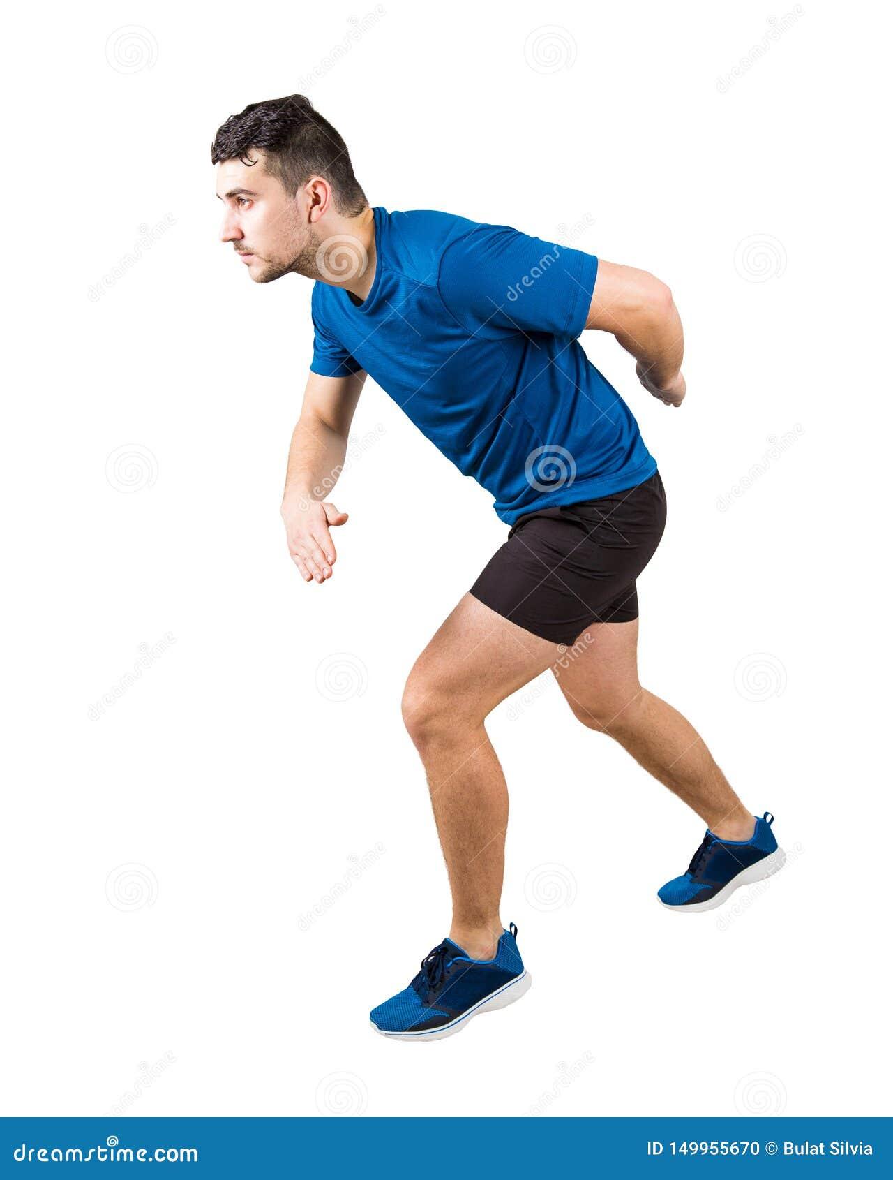 Πλήρες μήκος πλάγιας όψης του καθορισμένου καυκάσιου δρομέα ατόμων που στέκεται στο τρέξιμο της θέσης κοιτάζοντας μπροστά βέβαιας
