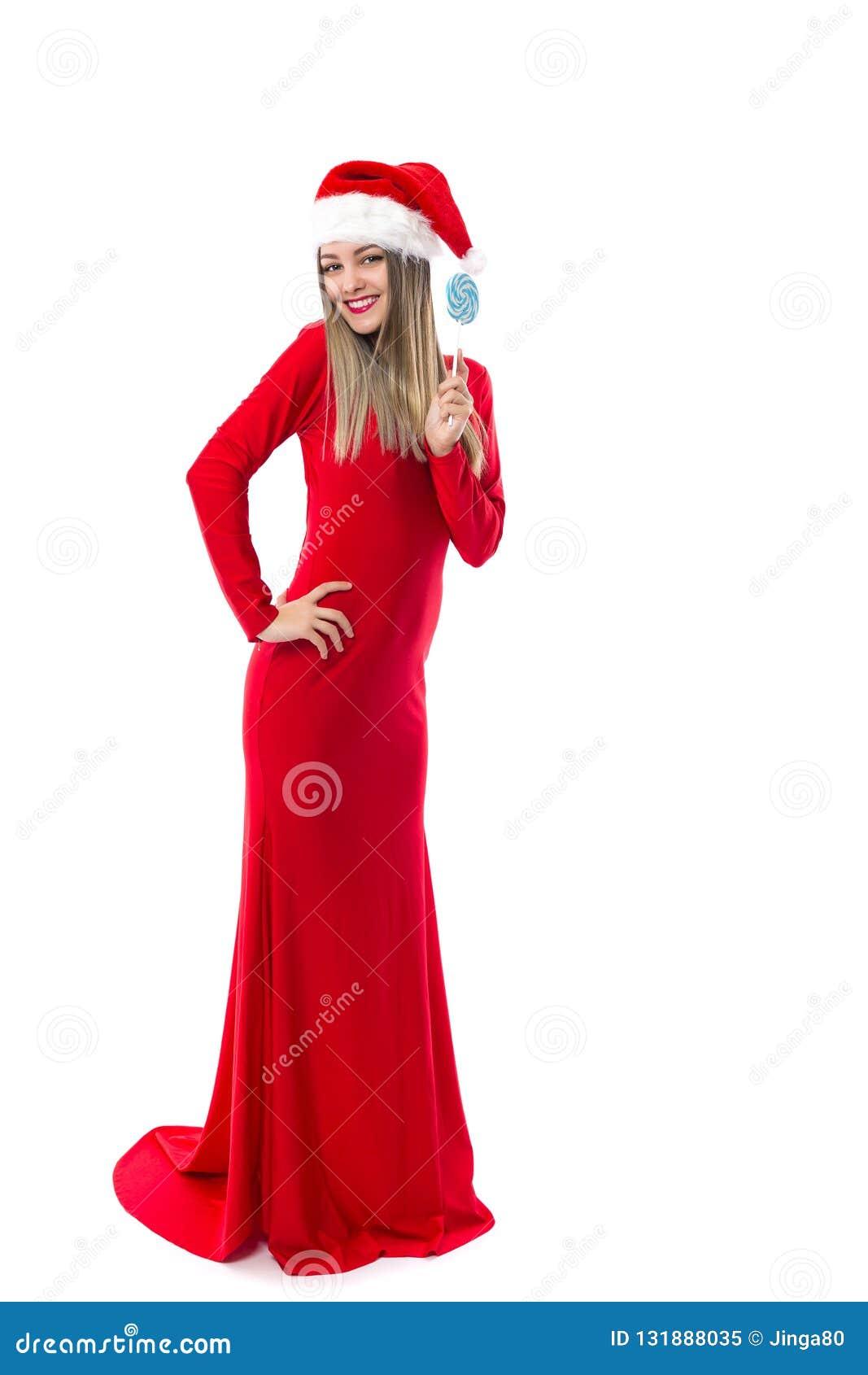 Πλήρες πορτρέτο μήκους του όμορφου κοριτσιού στο πολύ κόκκινο φόρεμα με το sa