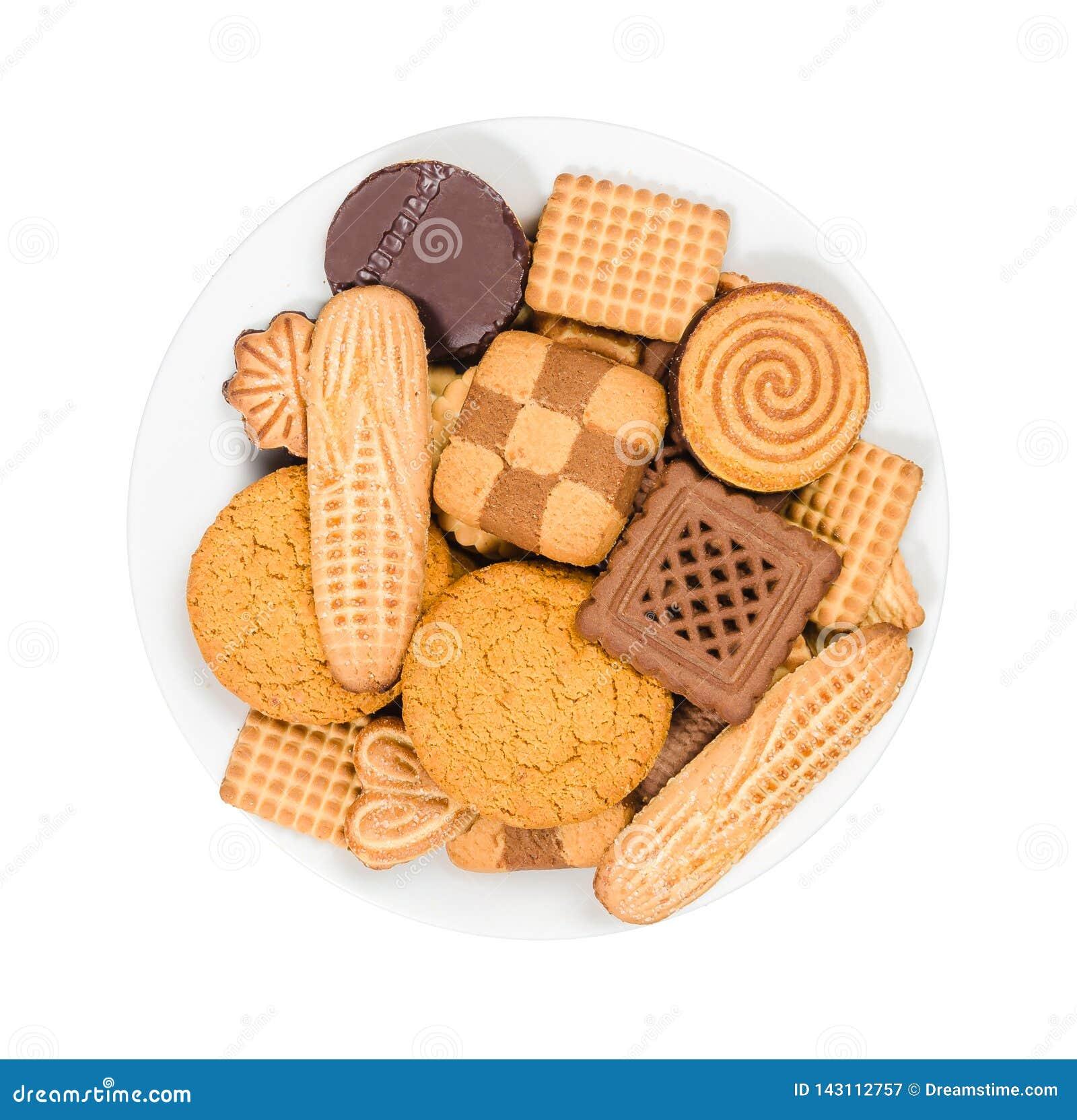 Ποικιλία των γλυκών μπισκότων σε ένα πιάτο στο άσπρο υπόβαθρο, τοπ άποψη
