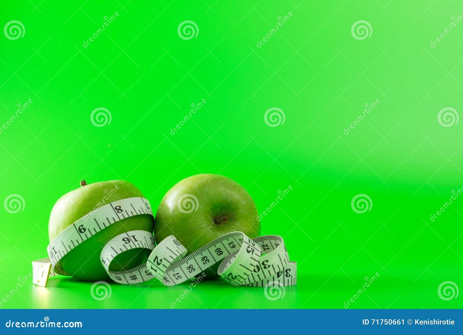 Πράσινο μήλο με ένα μέτρο ταινιών