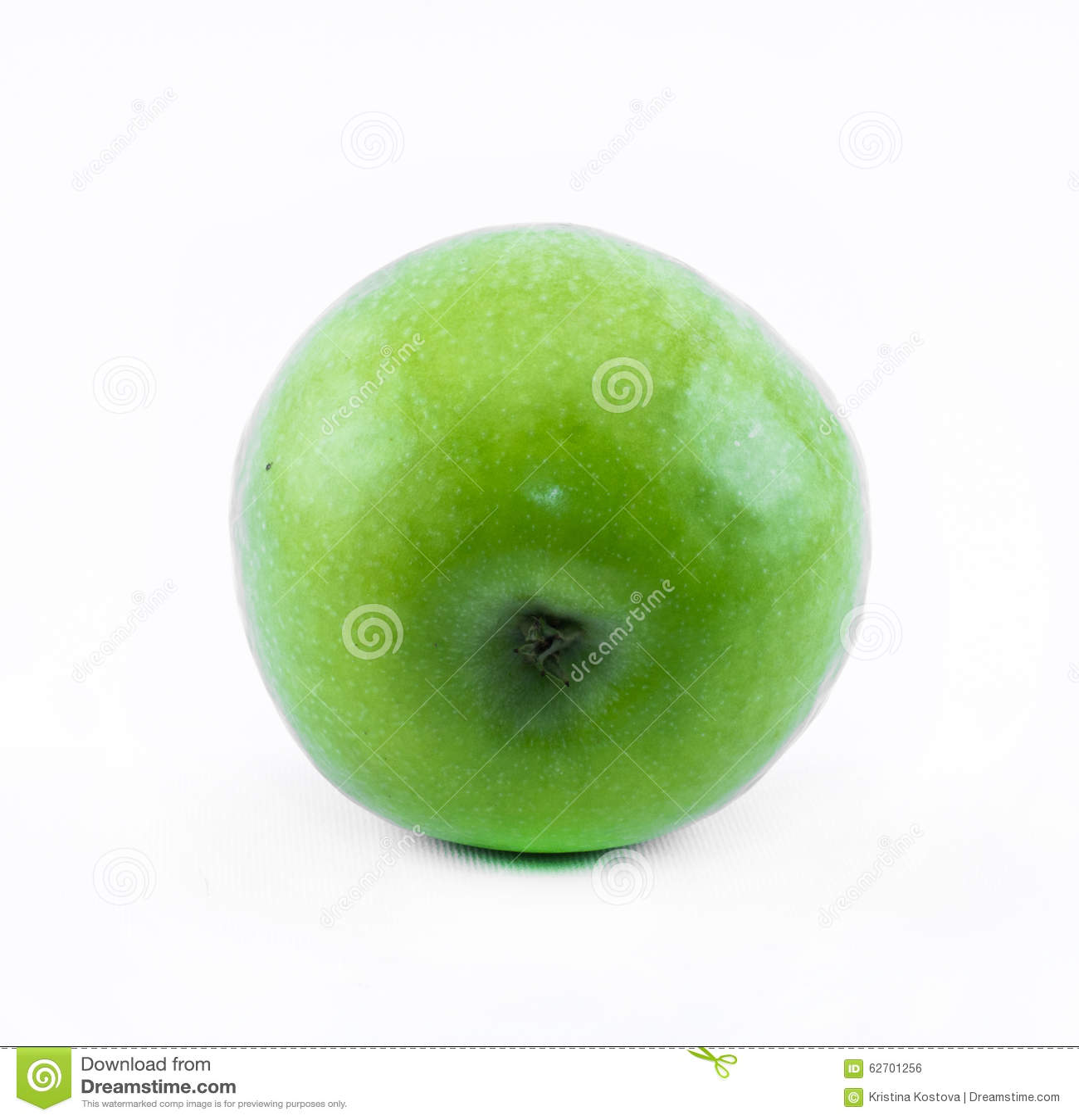 Πράσινο μήλο σε ένα άσπρο υπόβαθρο - πλάγια όψη