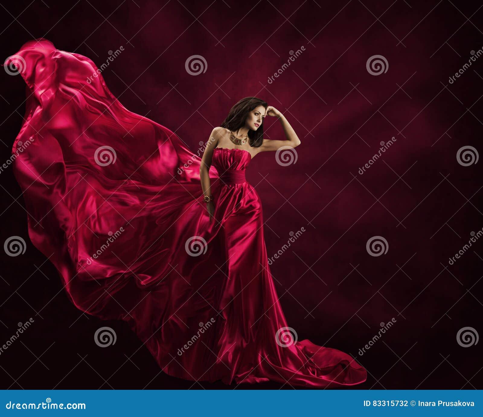 Πρότυπο φόρεμα μόδας, γυναίκα στην πετώντας εσθήτα, κυματίζοντας ύφασμα μεταξιού