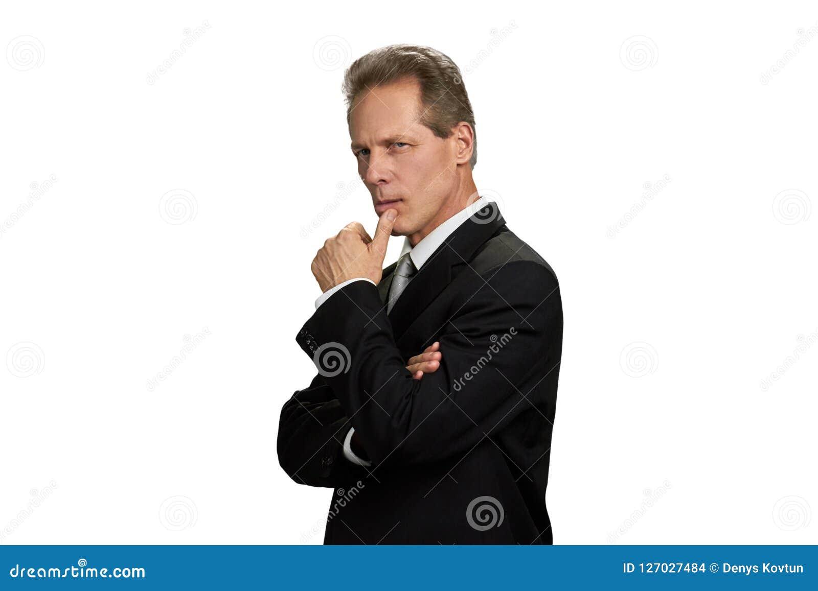 Σκεπτόμενος επιχειρηματίας με το δάχτυλο στο πηγούνι