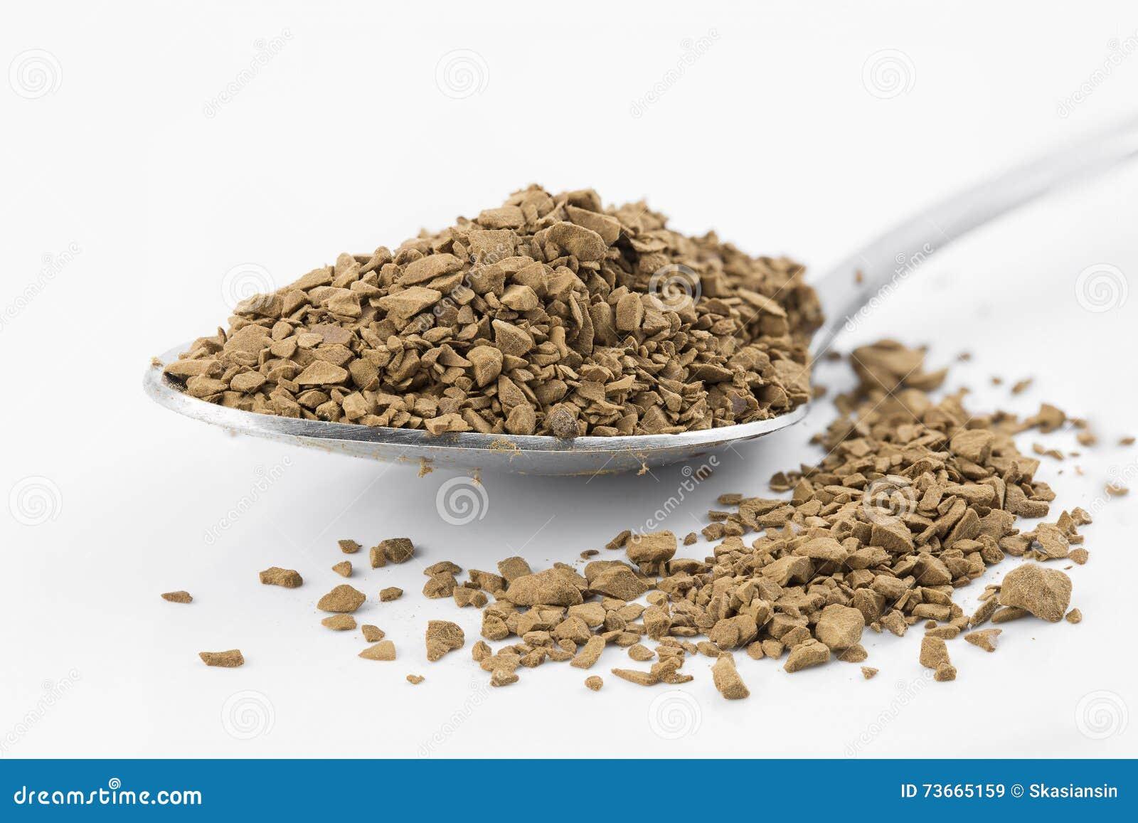 Σκόνη καφέ στο κουτάλι