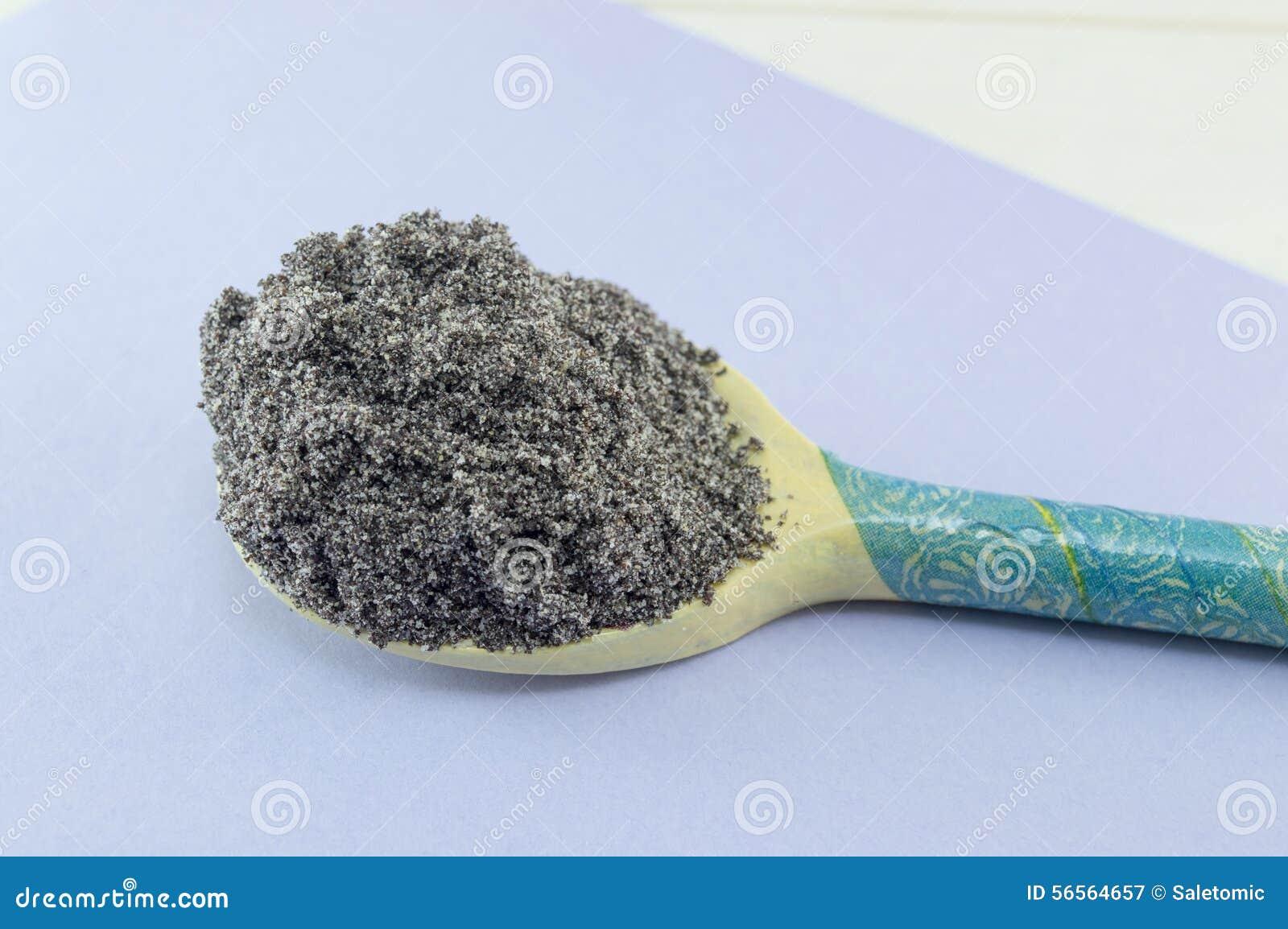 Download Σπόροι παπαρουνών σε ένα διακοσμημένο Decoupage κουτάλι Στοκ Εικόνα - εικόνα από καρύκευμα, συστατικό: 56564657