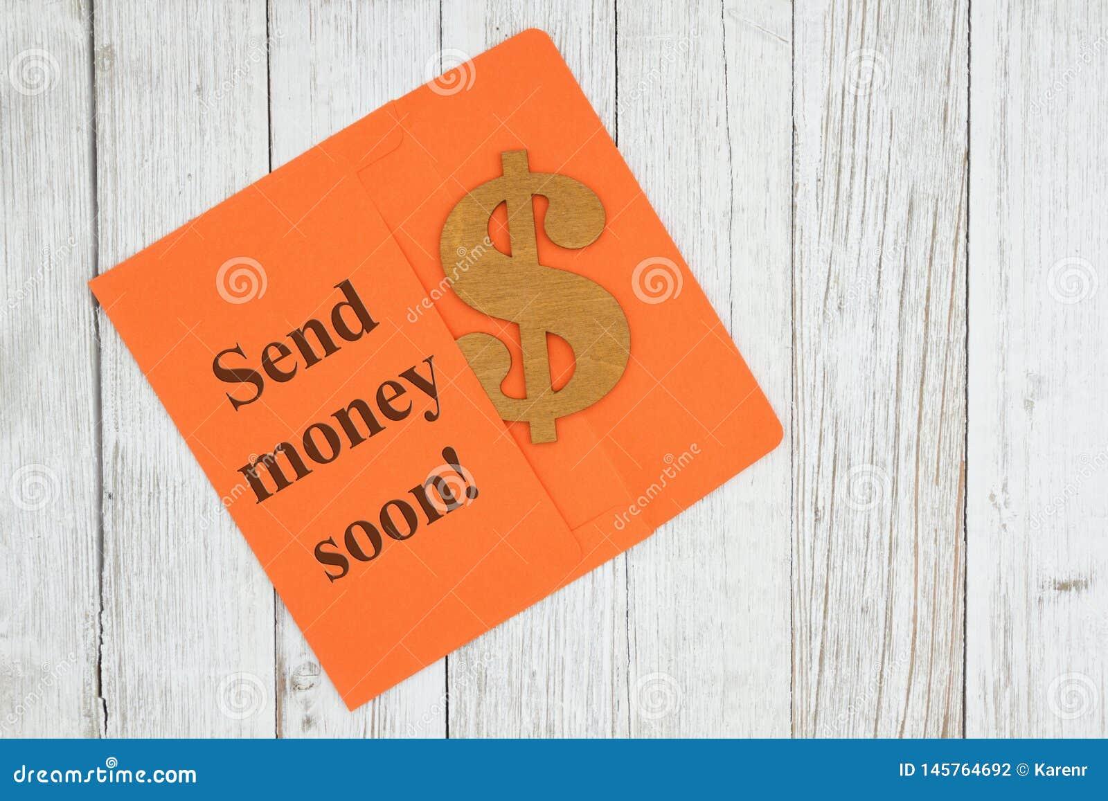 Στείλετε το κείμενο χρημάτων σύντομα με το σύμβολο σημαδιών δολαρίων με τον πορτοκαλή φάκελο στο κατασκευασμένο ξύλινο γραφείο