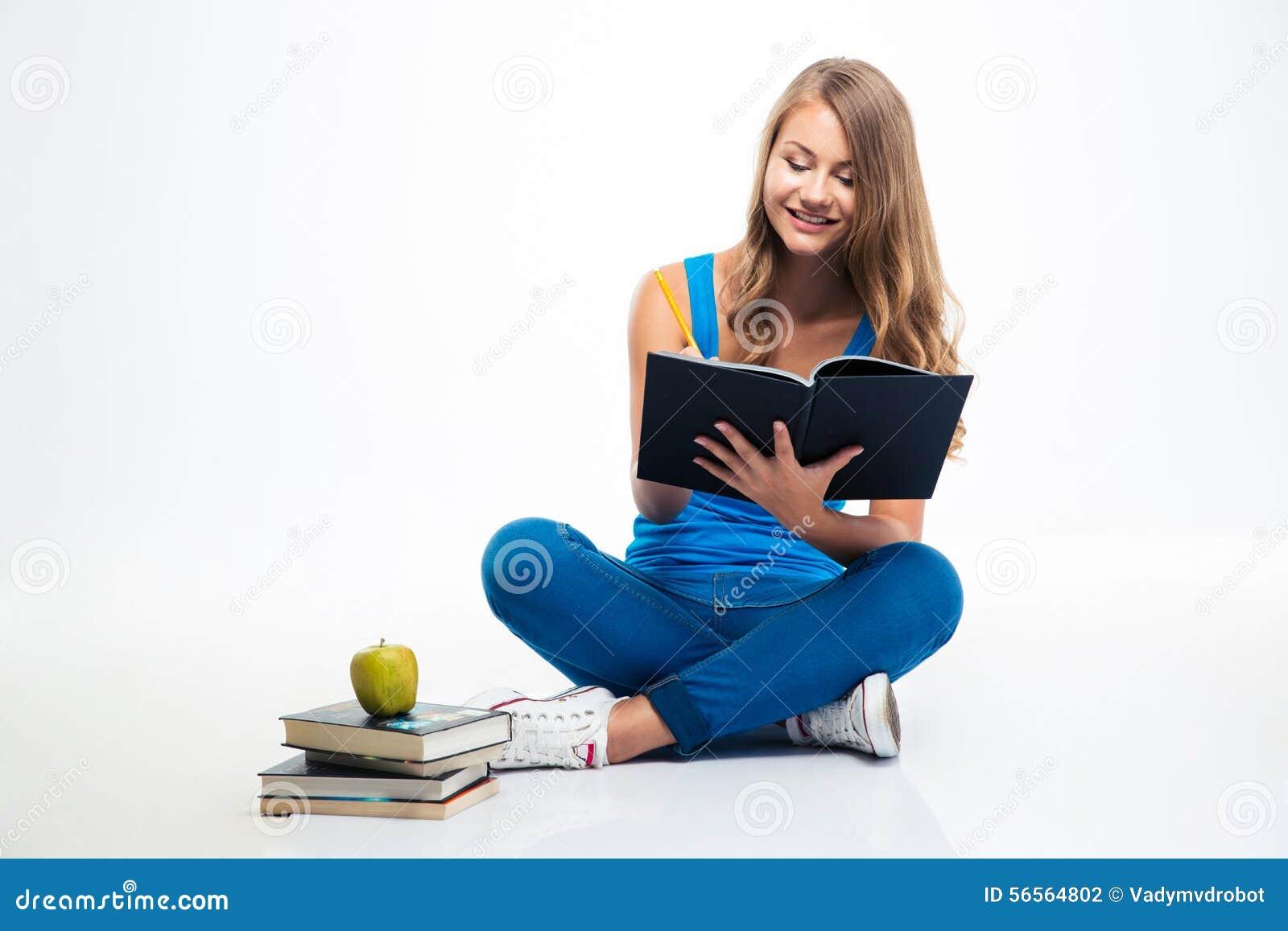 Download Συνεδρίαση κοριτσιών στις σημειώσεις πατωμάτων και γραψίματος Στοκ Εικόνες - εικόνα από σημειώσεις, περιστασιακός: 56564802