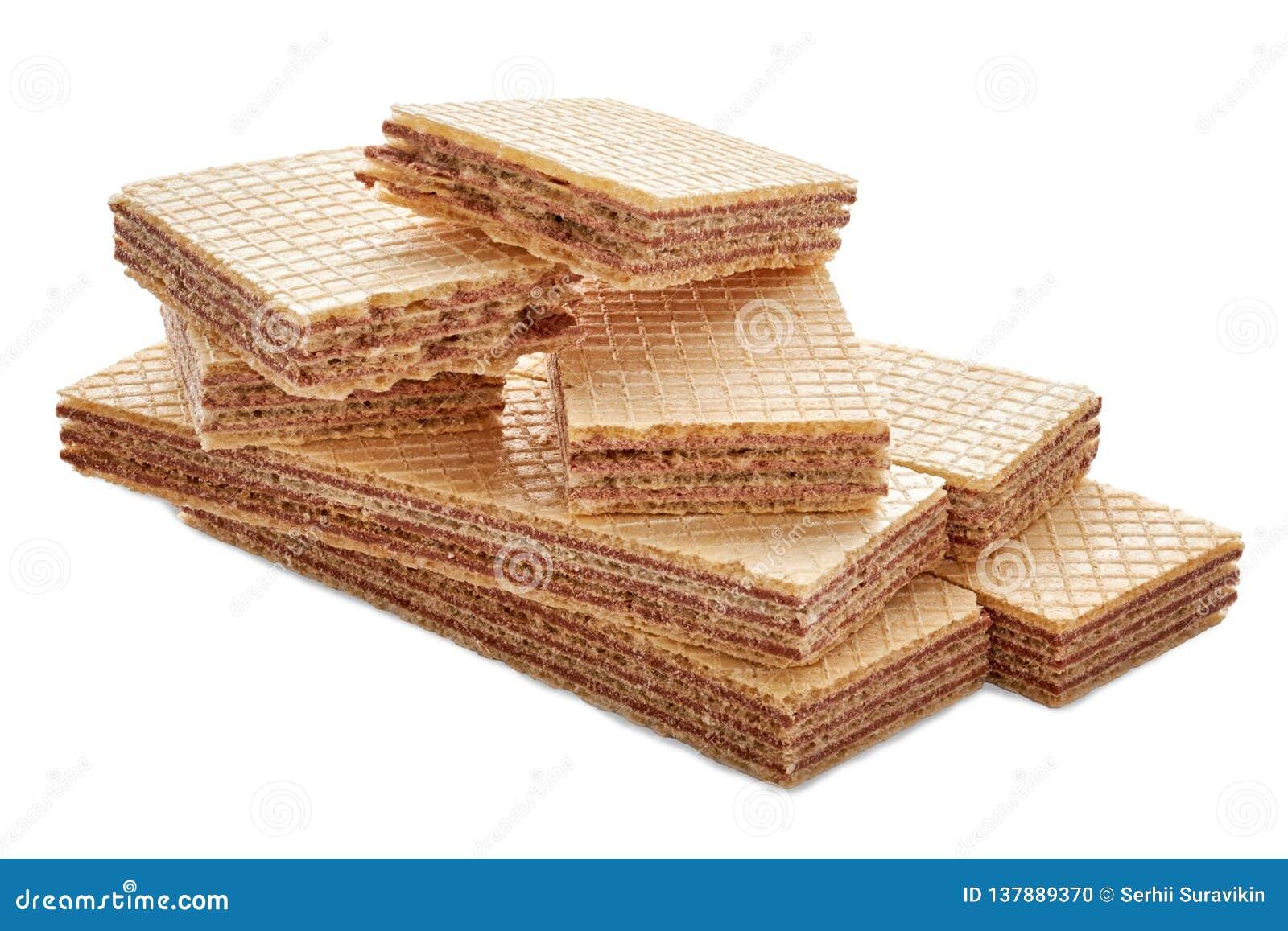 Σωρός ορθογώνιου των διαμορφωμένων μπισκότων και γκοφρετών που σπάζουν διχοτομημένος σε δύο κομμάτια