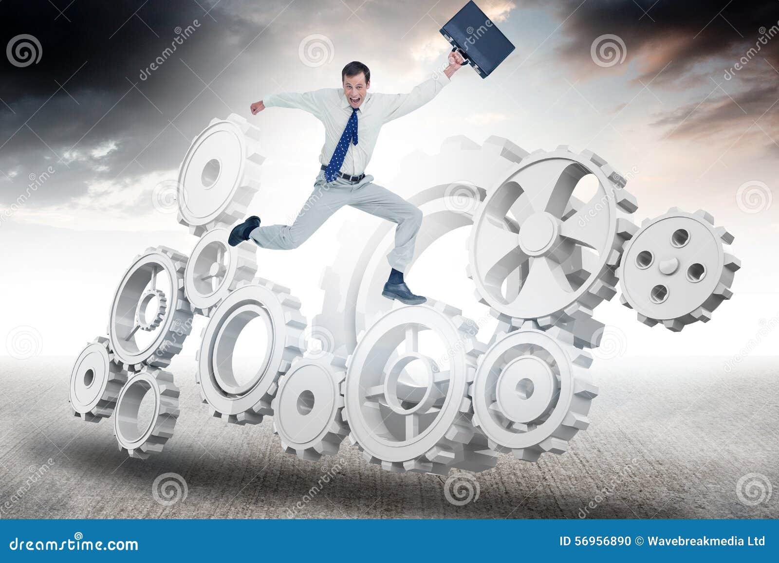 Σύνθετη εικόνα του εύθυμου πηδώντας επιχειρηματία με τη βαλίτσα του
