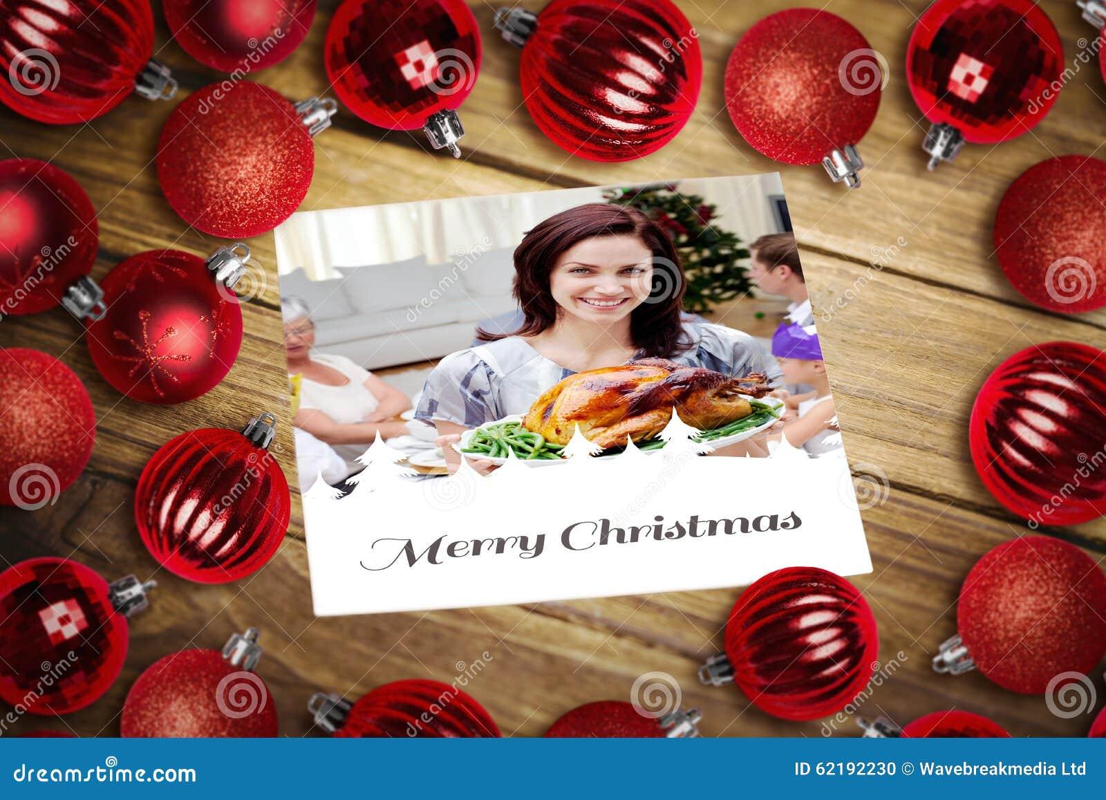Σύνθετη εικόνα των μπιχλιμπιδιών Χριστουγέννων στον πίνακα