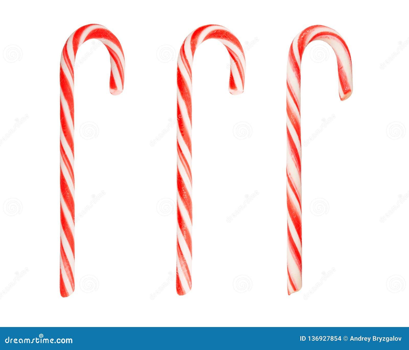 Σύνολο παραδοσιακού καλάμου καραμελών διακοπών τρία ριγωτού στα χρώματα Χριστουγέννων που απομονώνονται στο άσπρο υπόβαθρο