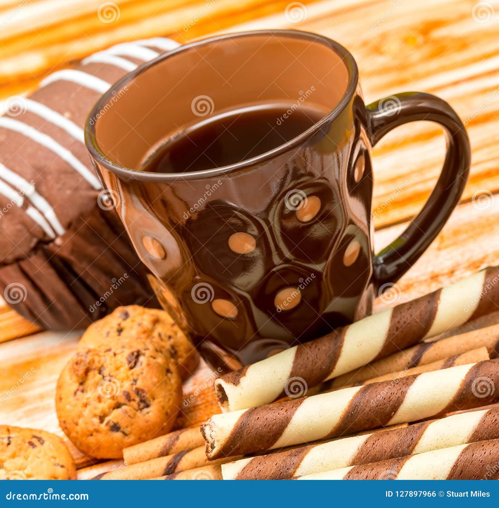 Τα μπισκότα διαλειμμάτων δείχνουν τα μπισκότα και το ποτό Decaf