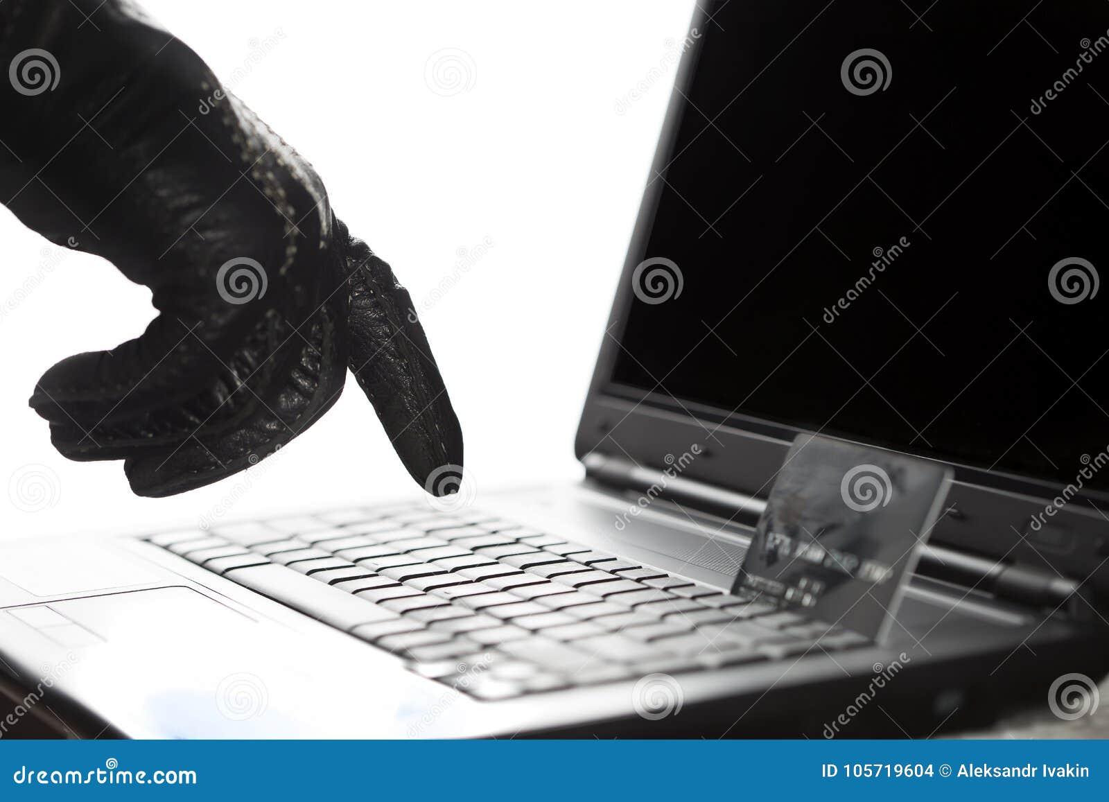 Τους χάκερ που φορούν γάντια δίνουν στην εργασία για ένα lap-top