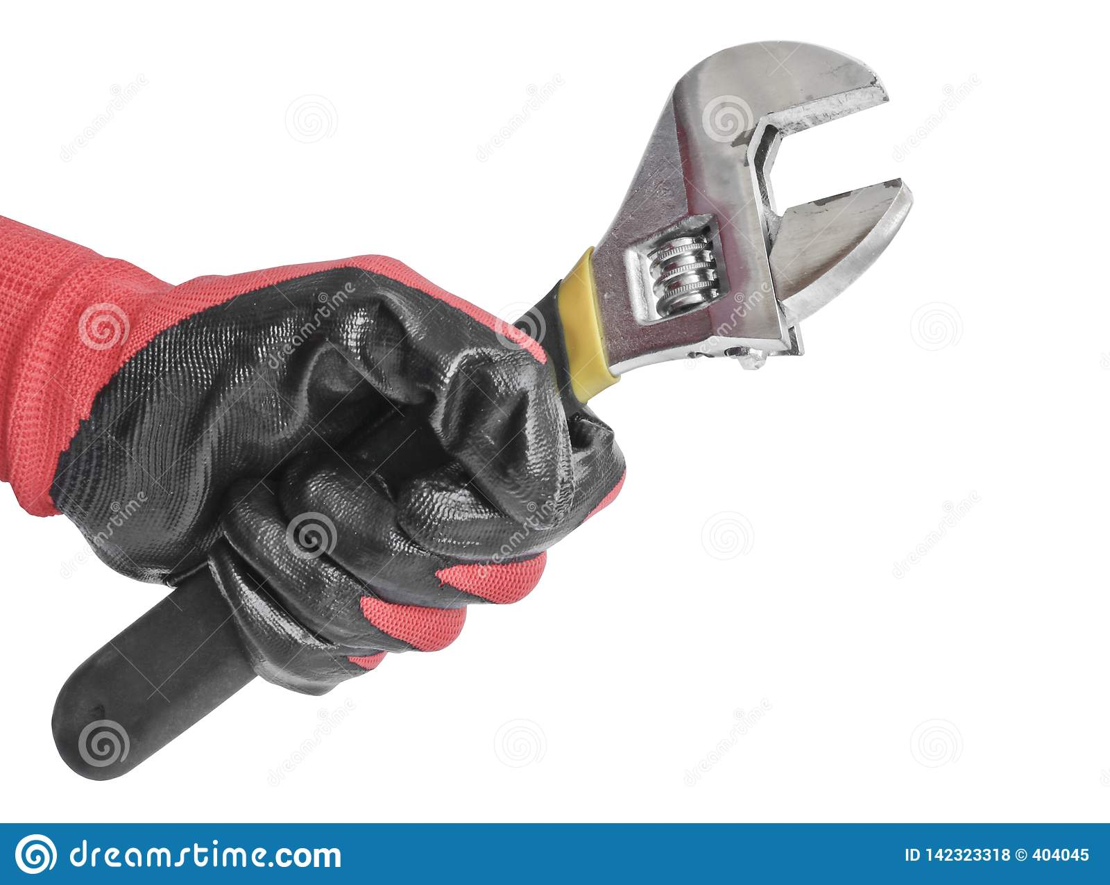 Το διευθετήσιμο γαλλικό κλειδί σε έναν ανθρώπινο παραδίδει ένα κόκκινο λειτουργώντας γάντι Εργαλείο κλειδαράδων