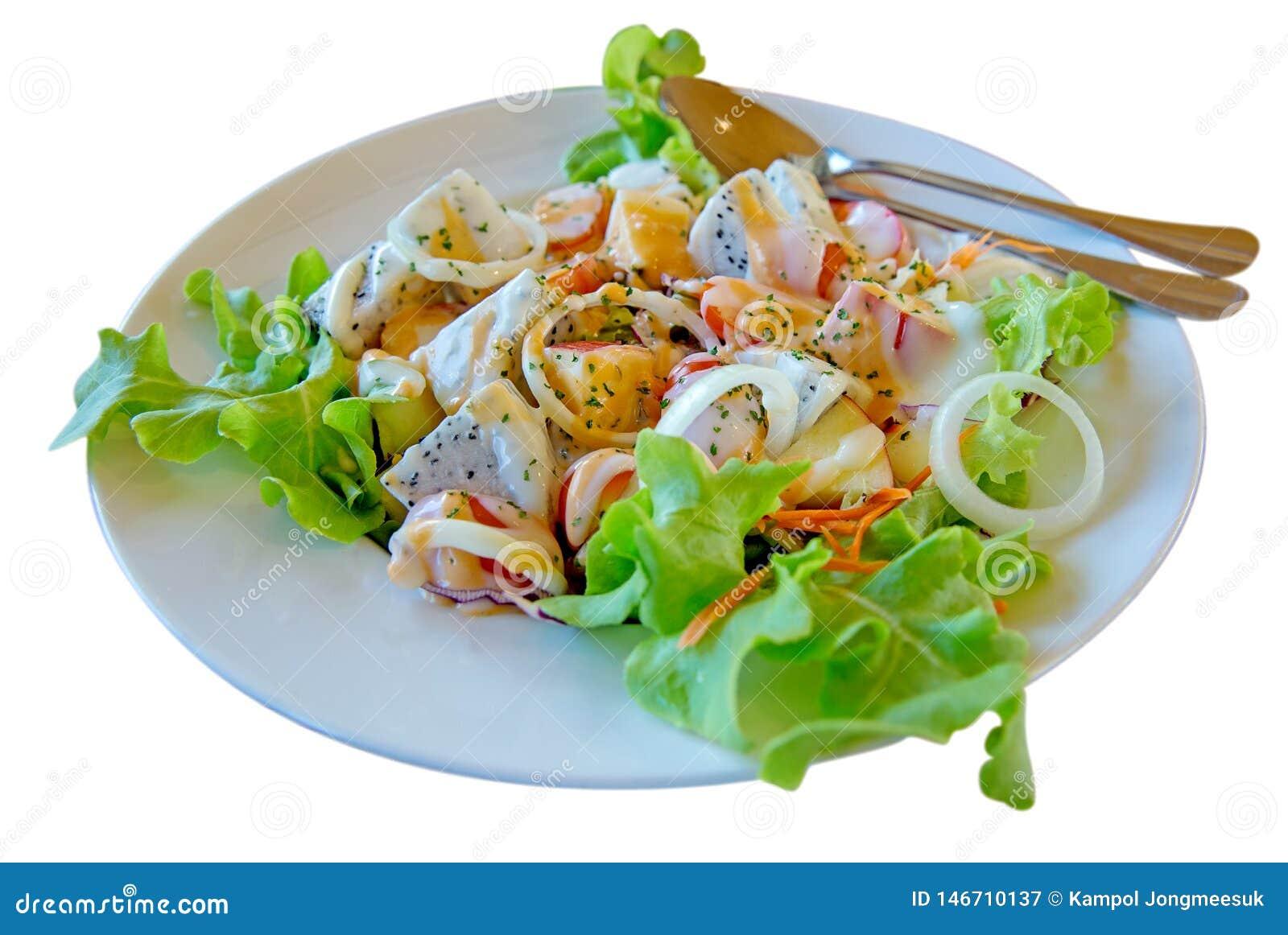 Το πράσινες βουτύρου λαχανικό μαρουλιού και η κρέμα σαλάτας φρούτων μιγμάτων, στρέφουν εκλεκτικό