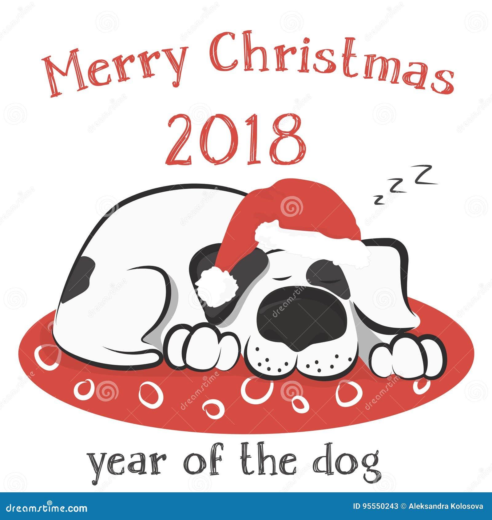 Το σκυλί κοιμάται στο μαξιλάρι στο καπέλο Santa