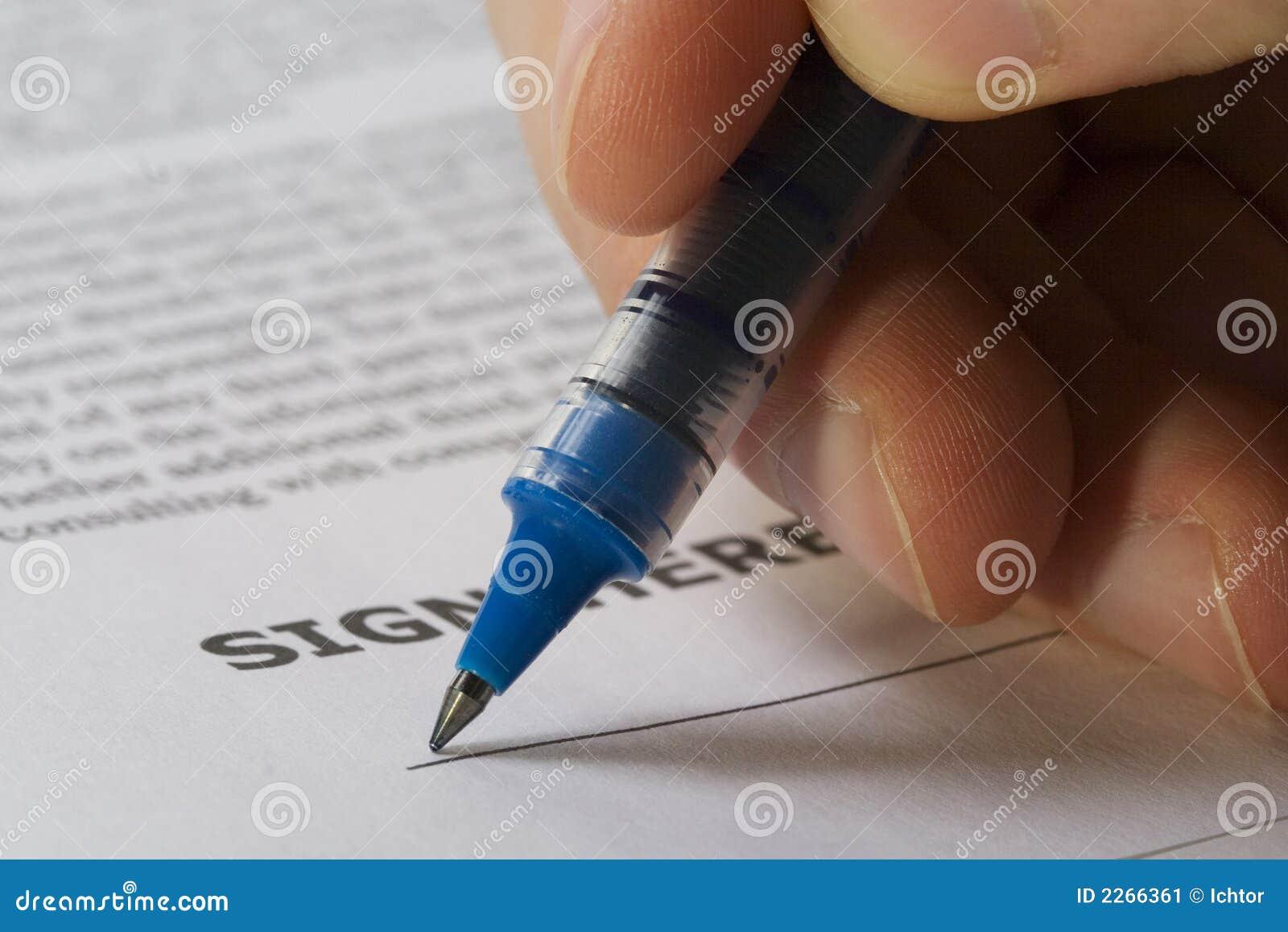 το χέρι υπογράφει εδώ