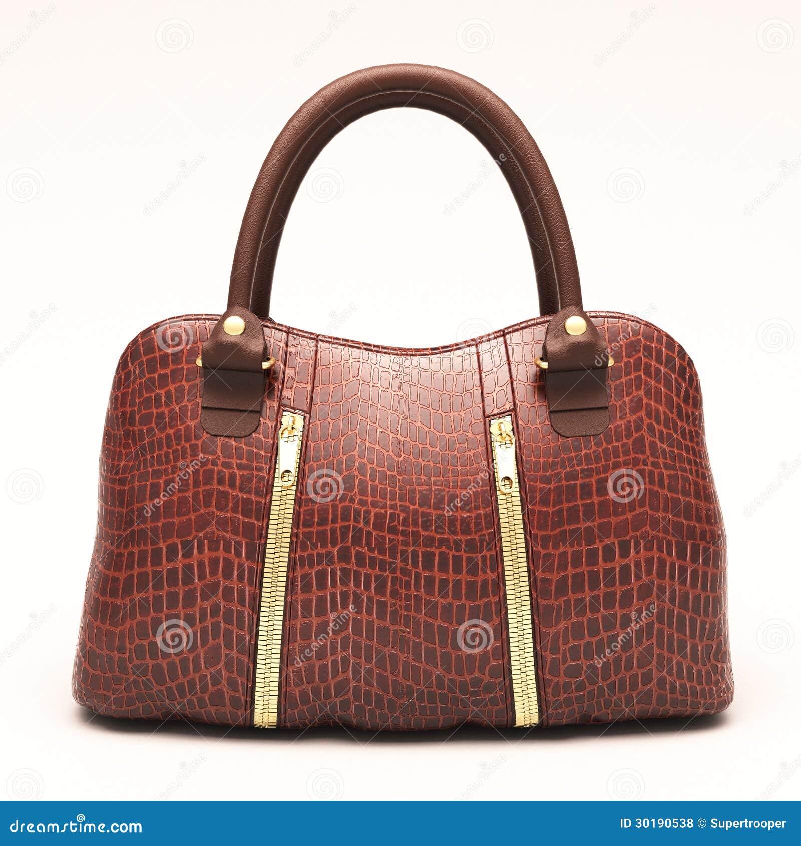 cd1b50a8e2 Τσάντα των γυναικών δέρματος κροκοδείλων που απομονώνεται στο άσπρο υπόβαθρο