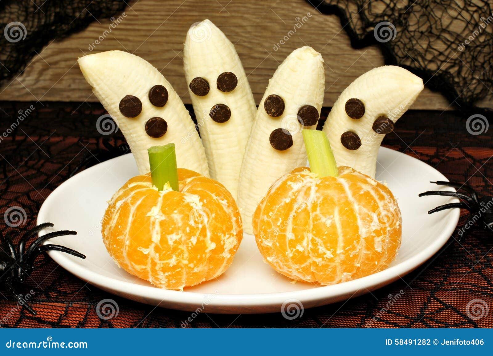 Υγιή φαντάσματα μπανανών αποκριών και πορτοκαλιές κολοκύθες