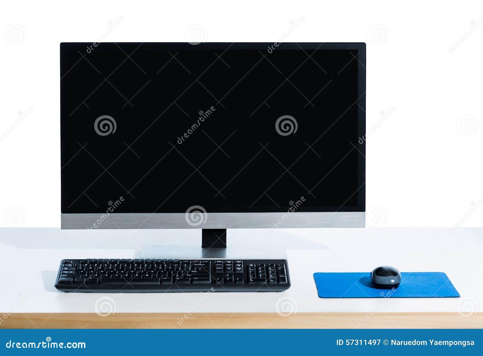 Υπολογιστής γραφείου με το έντονο φως οθόνης στο λευκό