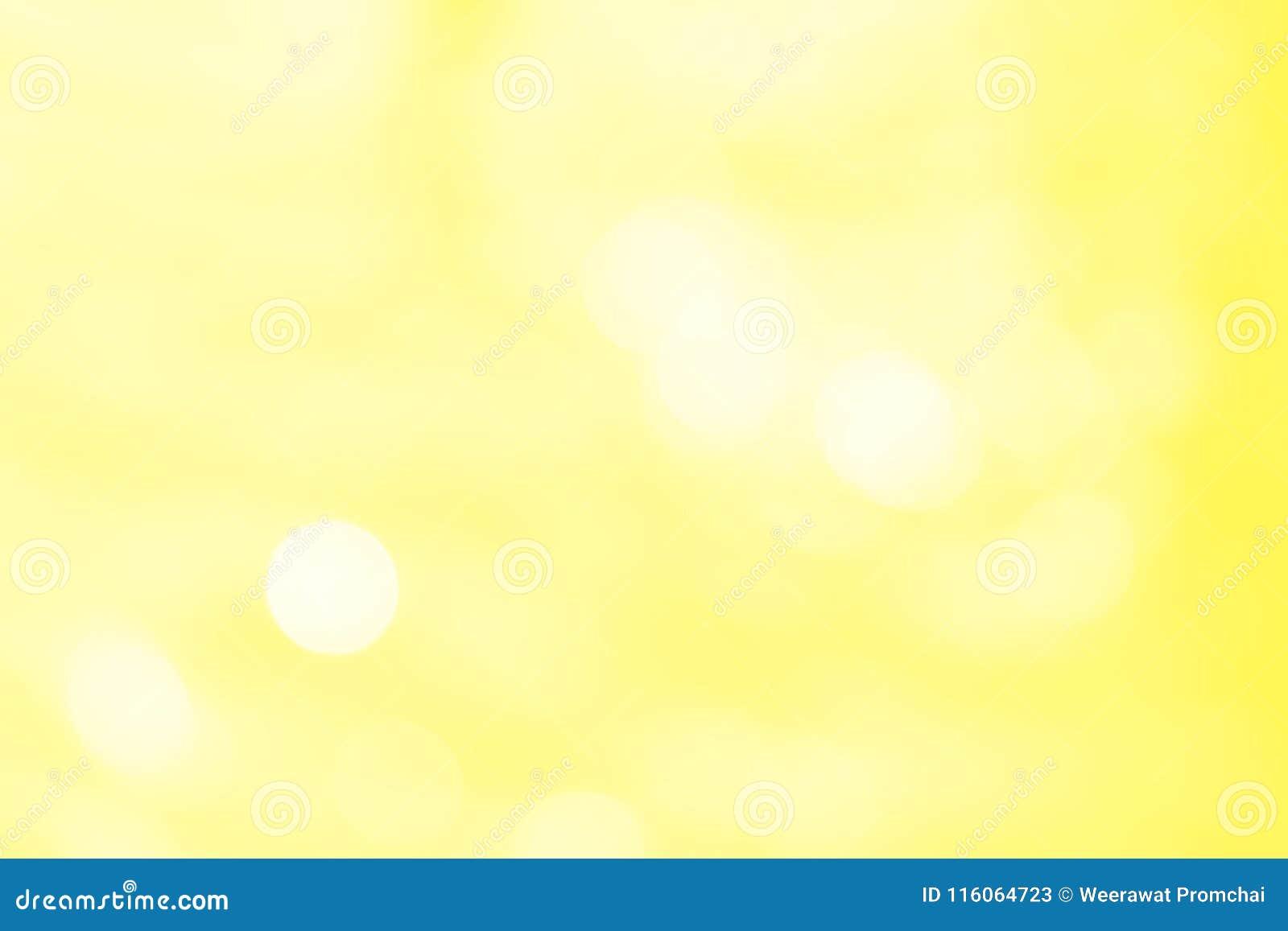 Φωτεινό ελαφρύ αφηρημένο κίτρινο υπόβαθρο χρώματος bokeh