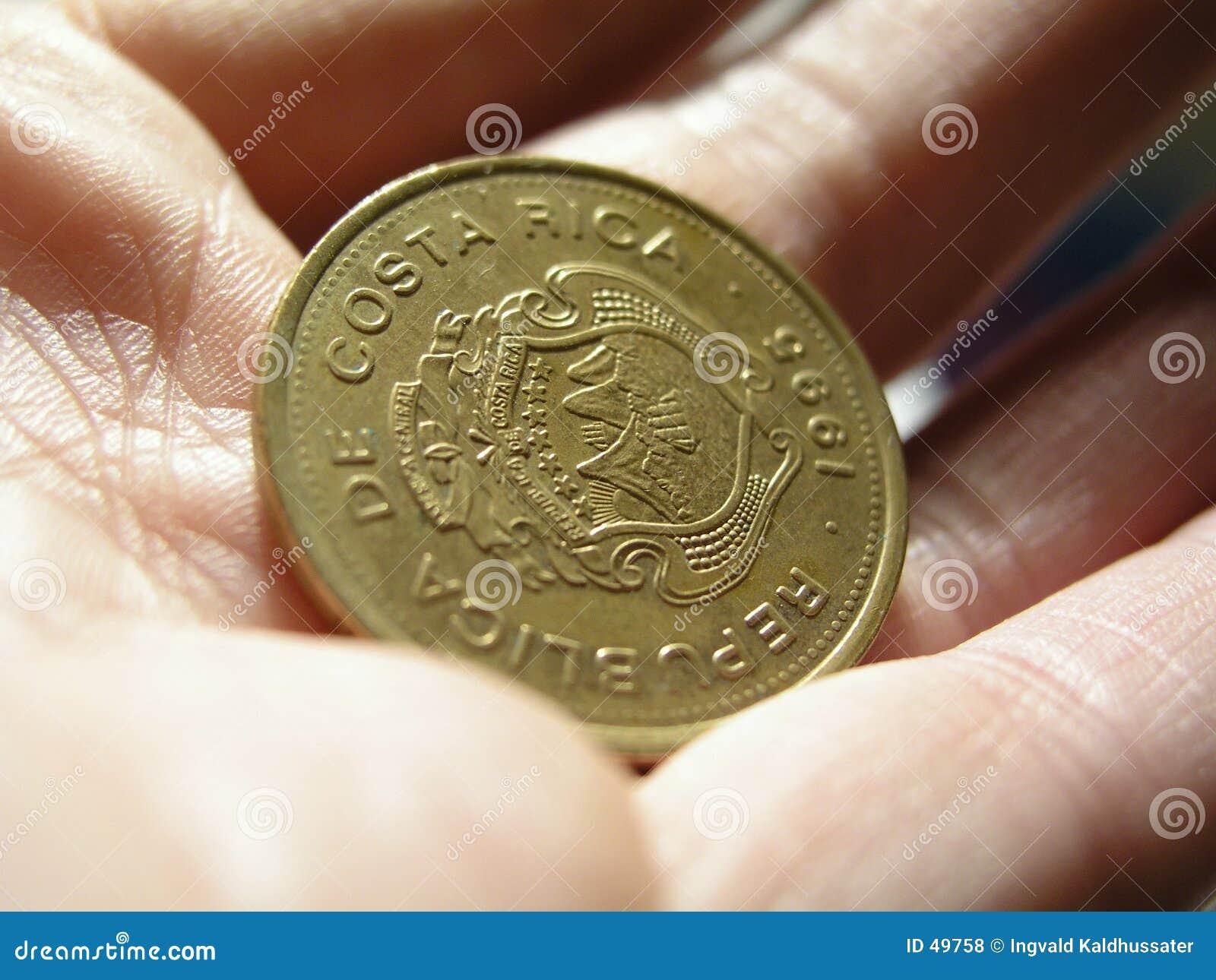χέρι νομισμάτων