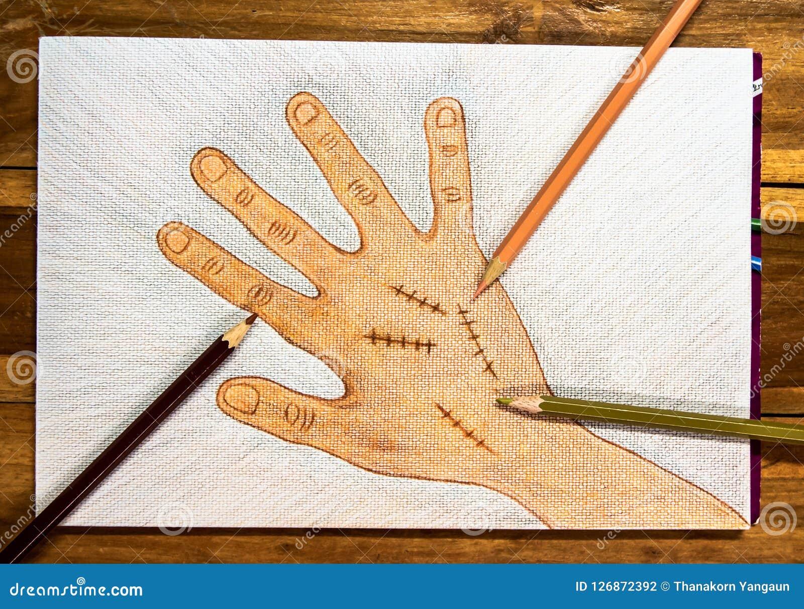 Χέρι που επισύρεται την προσοχή δεξί με τη χειρουργική συρραφή πληγών από τα ξύλινα μολύβια χρώματος στο υπόβαθρο της Λευκής Βίβλ