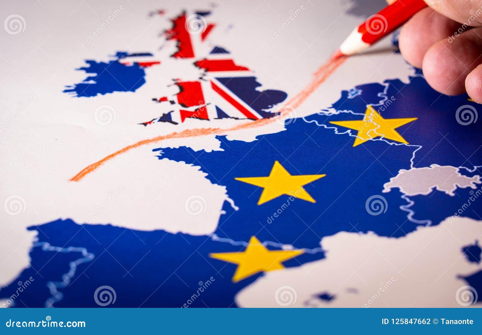 Χέρι που σύρει μια κόκκινη γραμμή μεταξύ του UK και του υπολοίπου της ΕΕ, έννοια Brexit