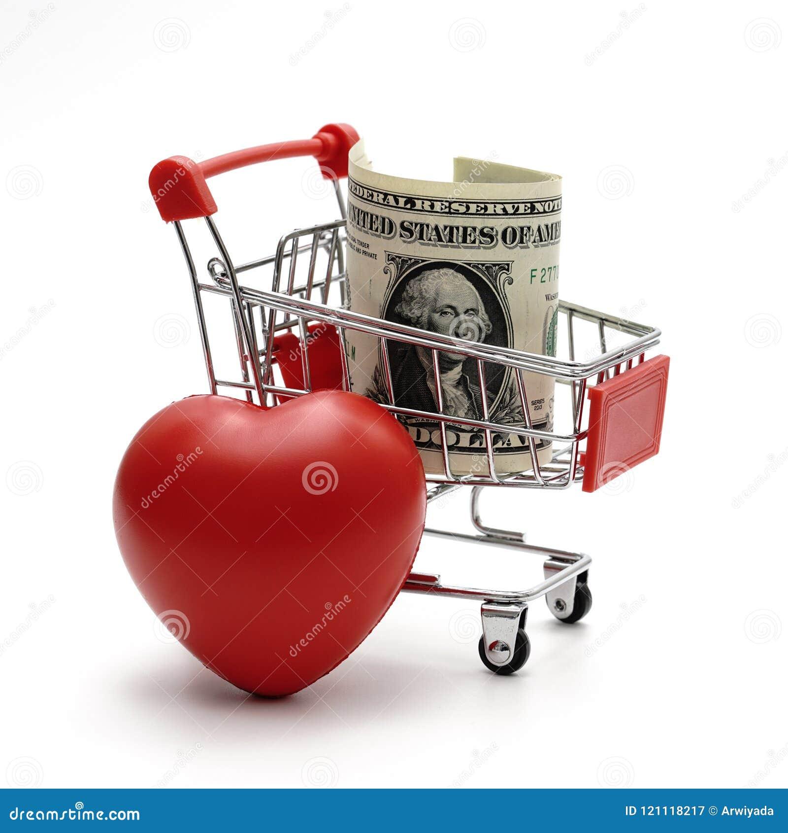 Χρήματα και καρδιά δολαρίων με το κάρρο αγορών στο άσπρο υπόβαθρο SH
