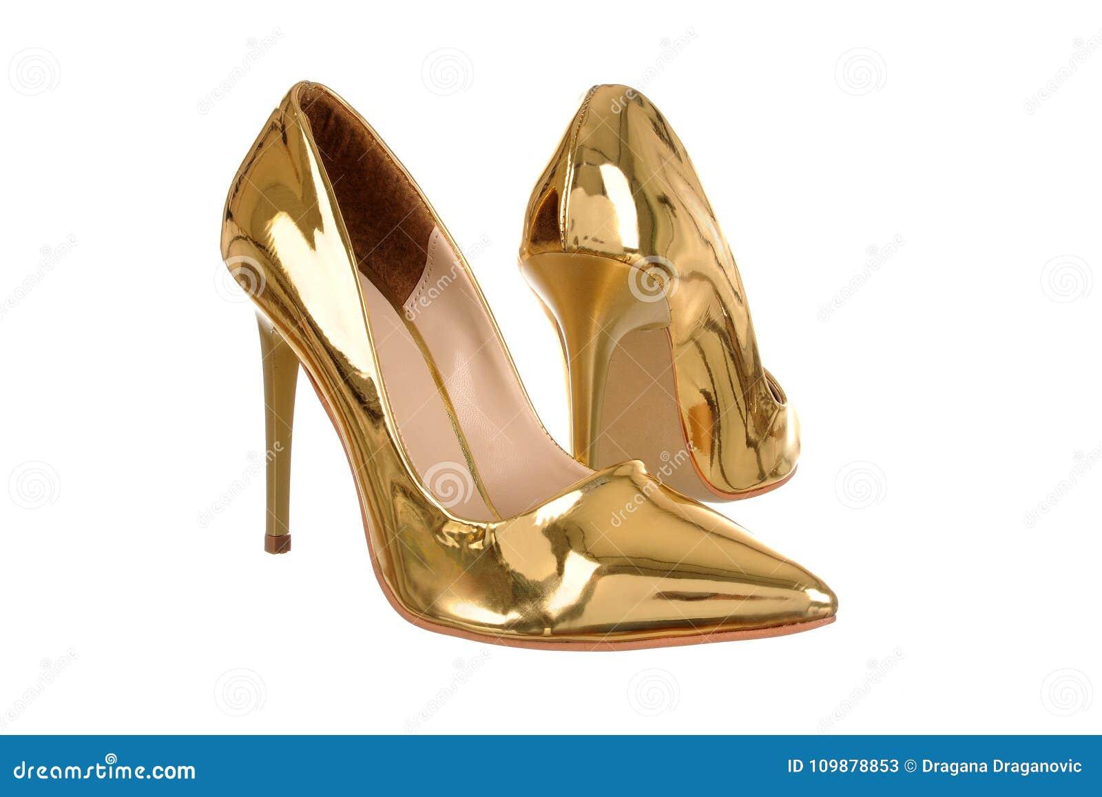 0be6c5b60a9 Χρυσά υψηλά παπούτσια γυναικών τακουνιών Στοκ Εικόνα - εικόνα από ...