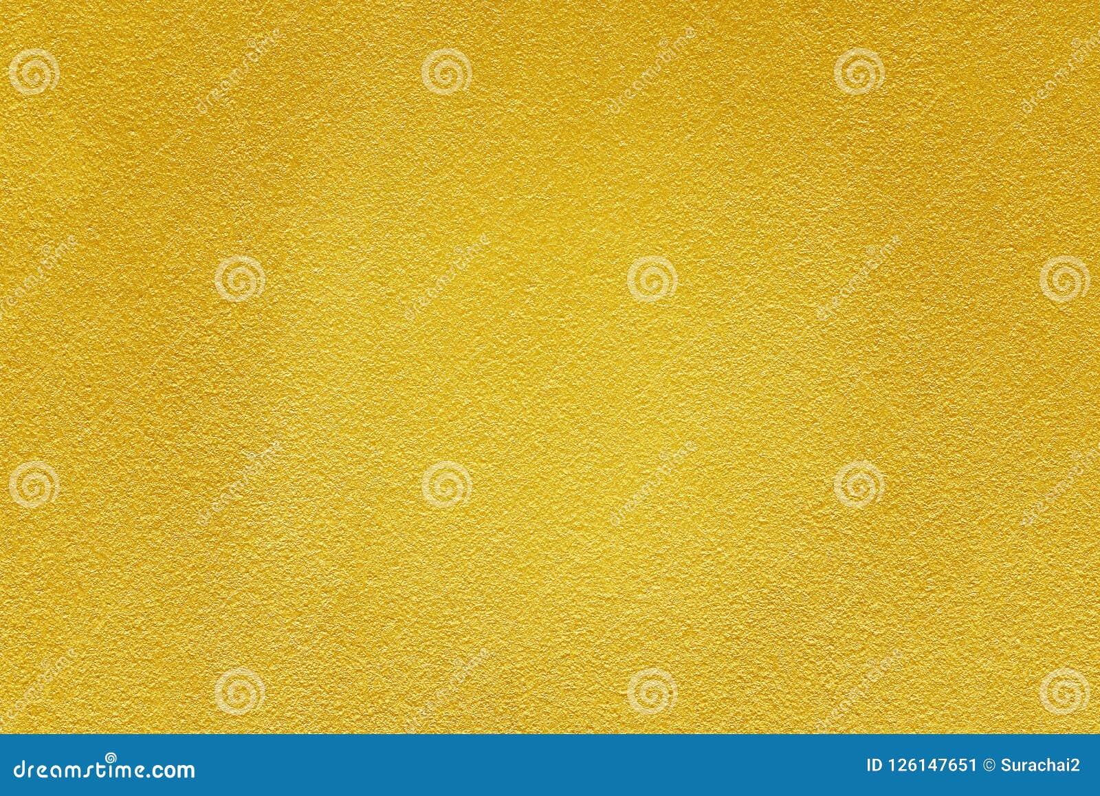 Χρυσό χρώμα στο τραχύ υπόβαθρο σύστασης τοίχων τσιμέντου