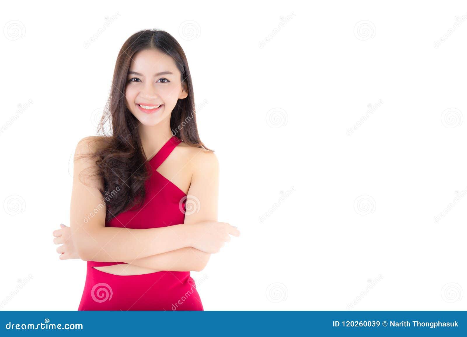 Όμορφο νέο ασιατικό χαμόγελο γυναικών του πορτρέτου που απομονώνεται στο άσπρο υπόβαθρο