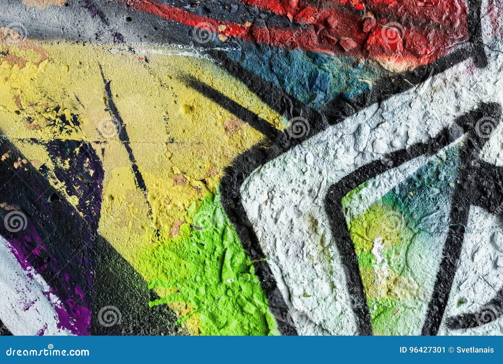 Абстрактная стена, украшенная с чертежами краской, конец-вверх Деталь граффити Часть для предпосылки, стильной картины
