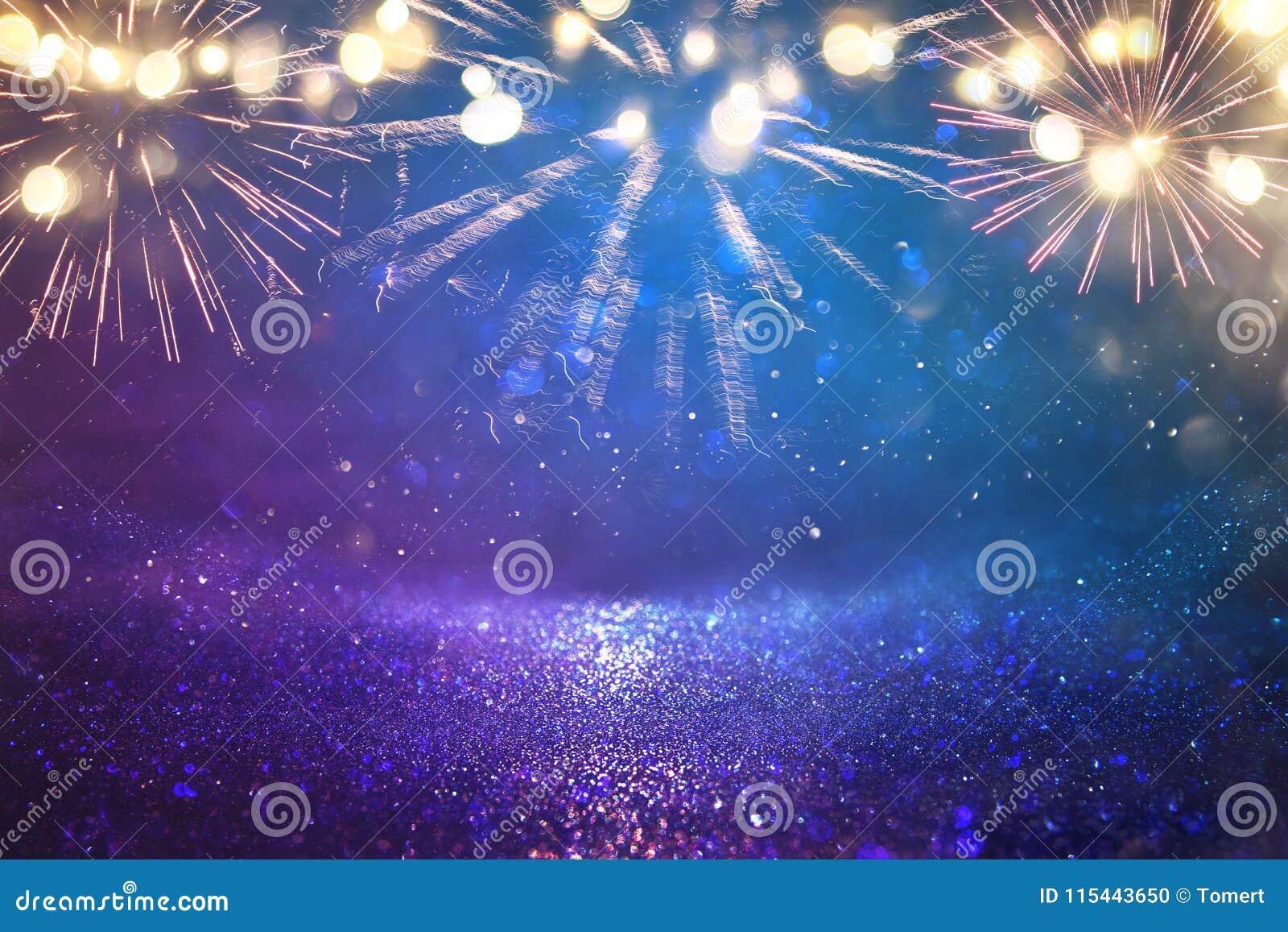 абстрактная чернота, золото и голубая предпосылка яркого блеска с фейерверками Рожденственская ночь, 4-ая из концепции праздника