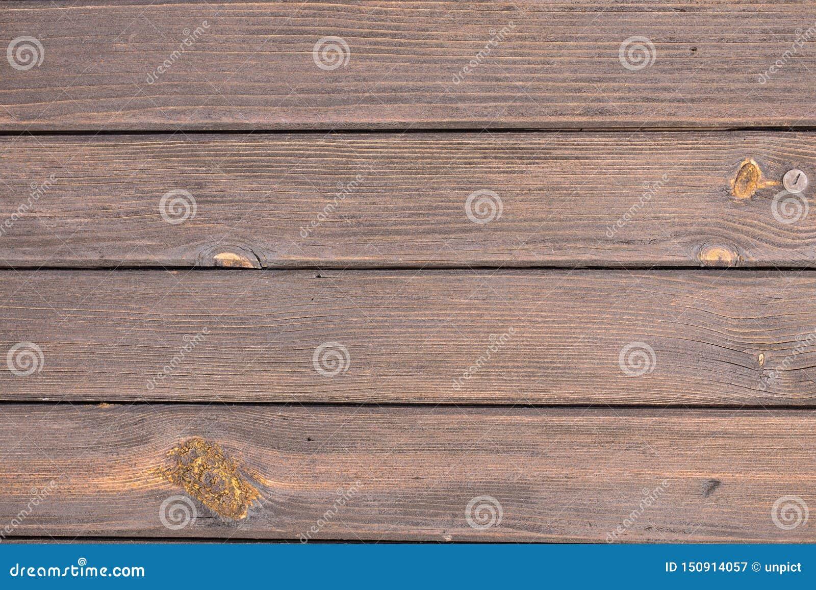 Абстрактные предпосылки: коричневые, более старые деревянные планки