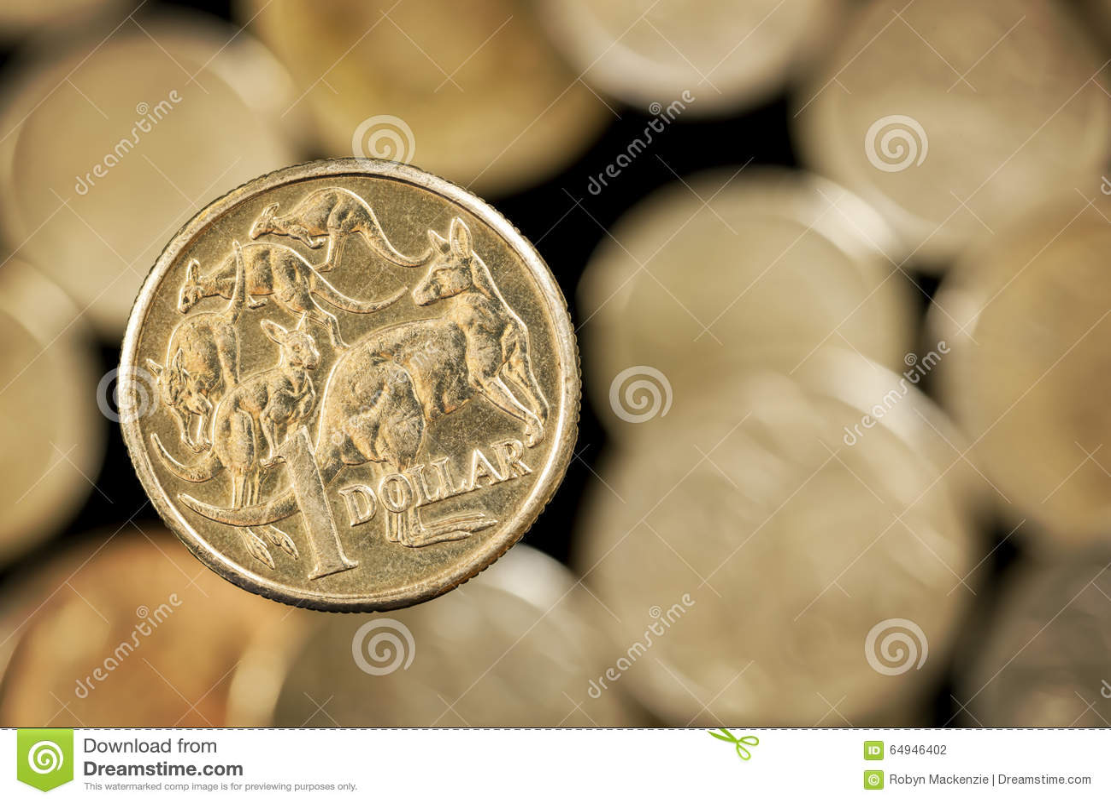 Австралиец одна монетка доллара над запачканной золотой предпосылкой