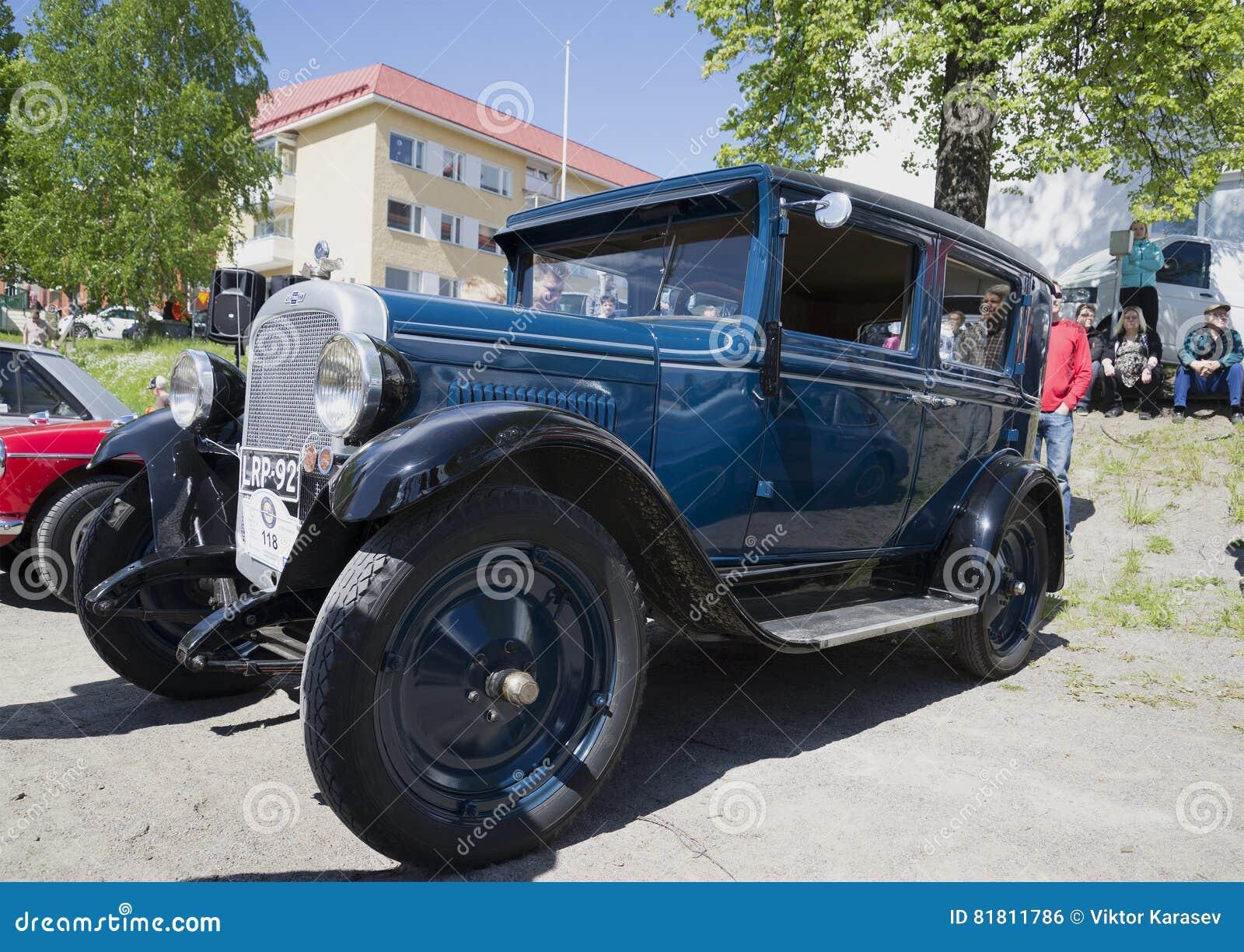 Автомобиль Шевроле 1929 v на выставке винтажных автомобилей стародедовский заход солнца savonlinna olavinlinna крепости Финляндии