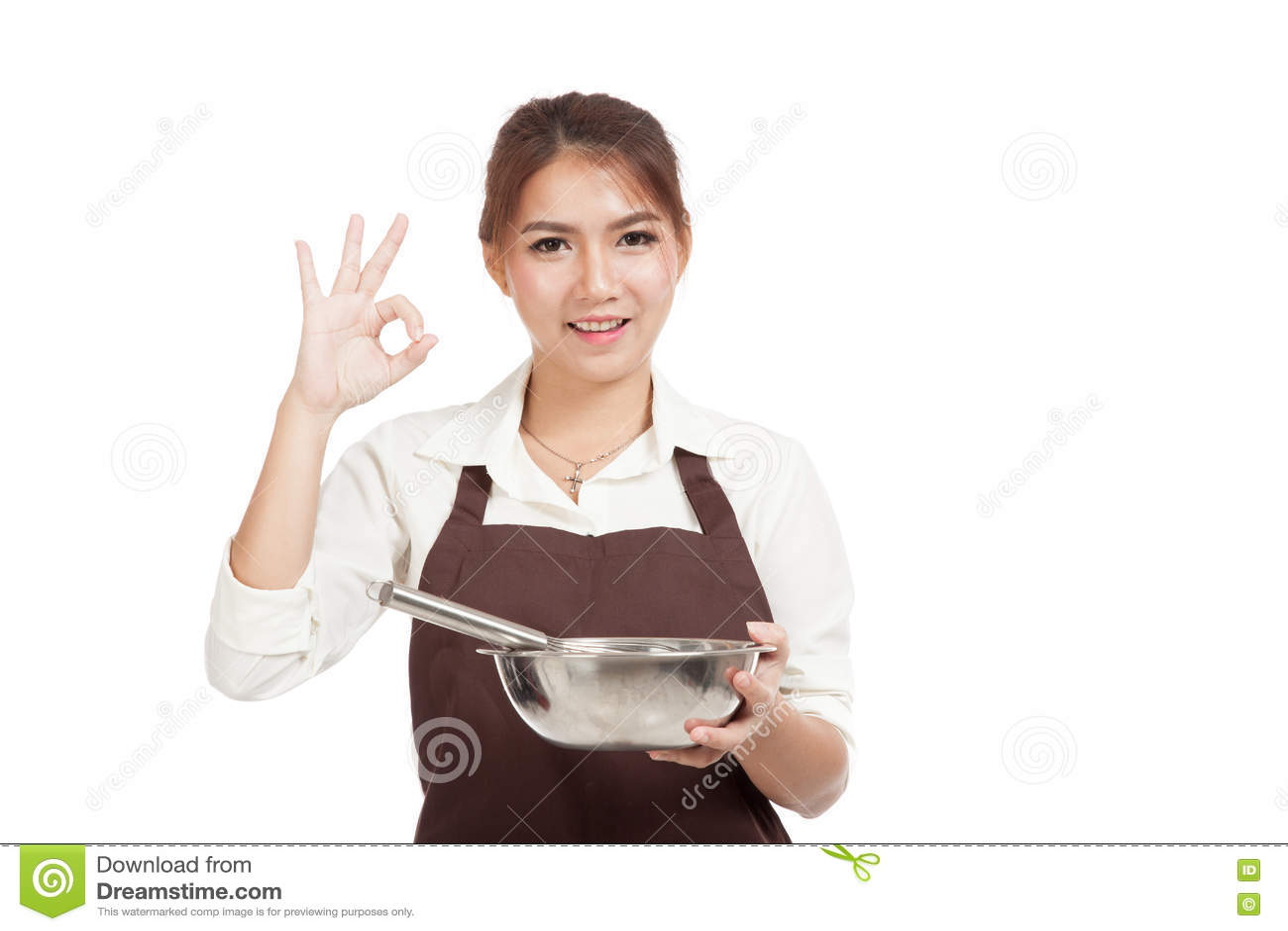 Азиатская девушка хлебопека с знак О КЕЙ выставки юркнет и шара