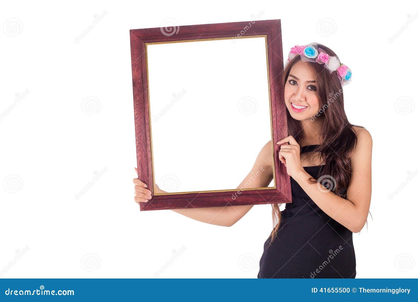 Азиатские женщины держа рамку от изображения