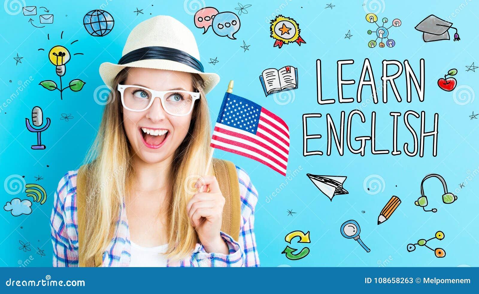 Английская тема при молодая женщина держа американский флаг