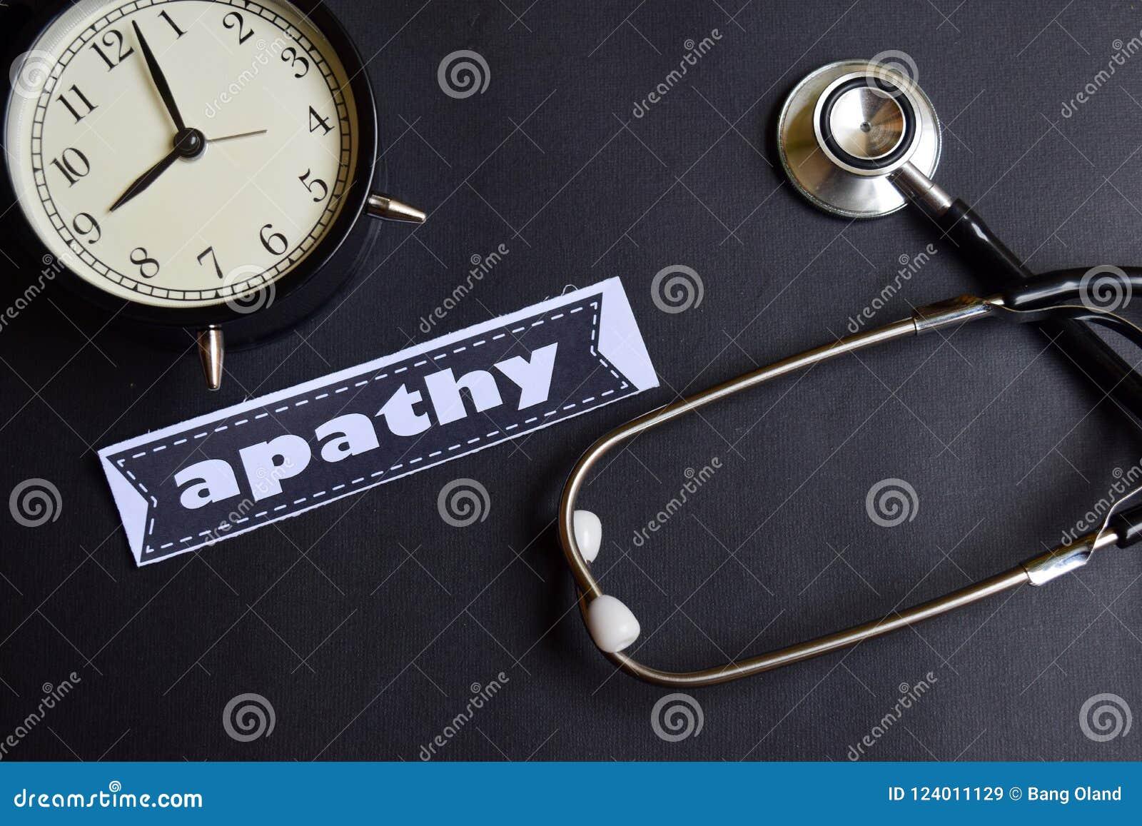 Апатия на бумаге с воодушевленностью концепции здравоохранения будильник, черный стетоскоп