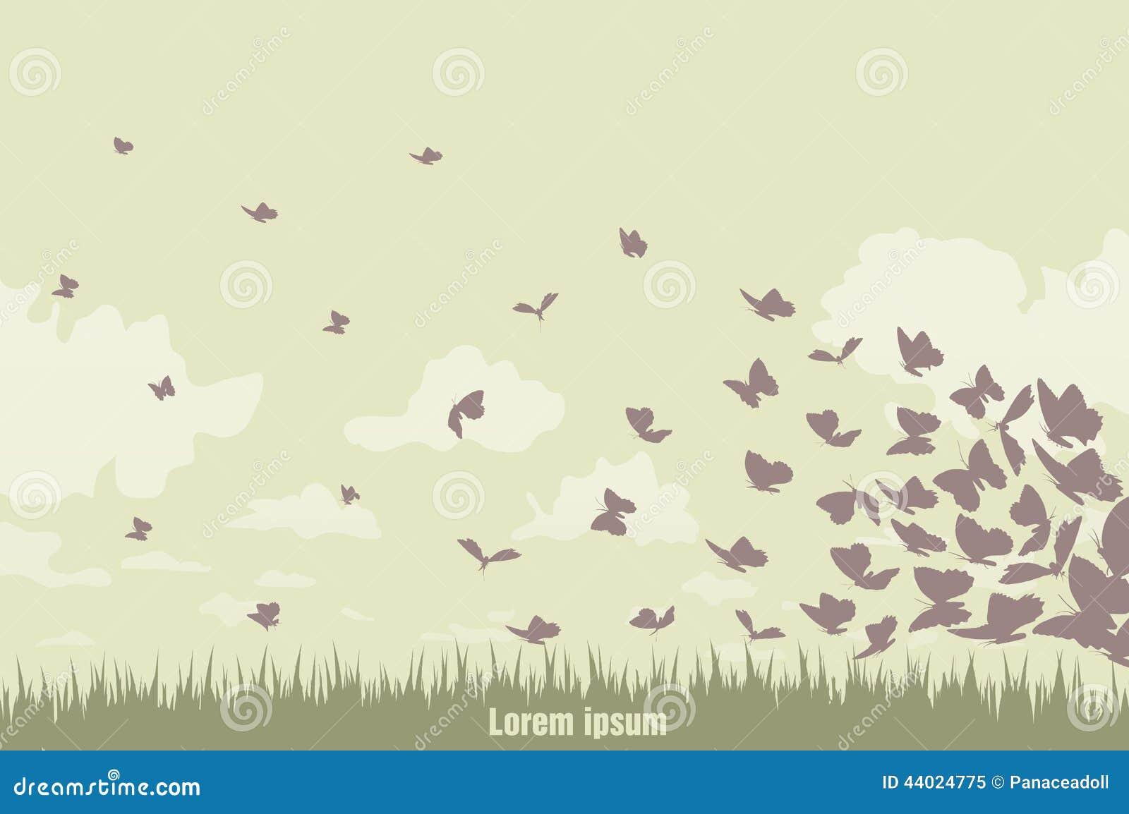 Бабочки летания на зеленом ландшафте